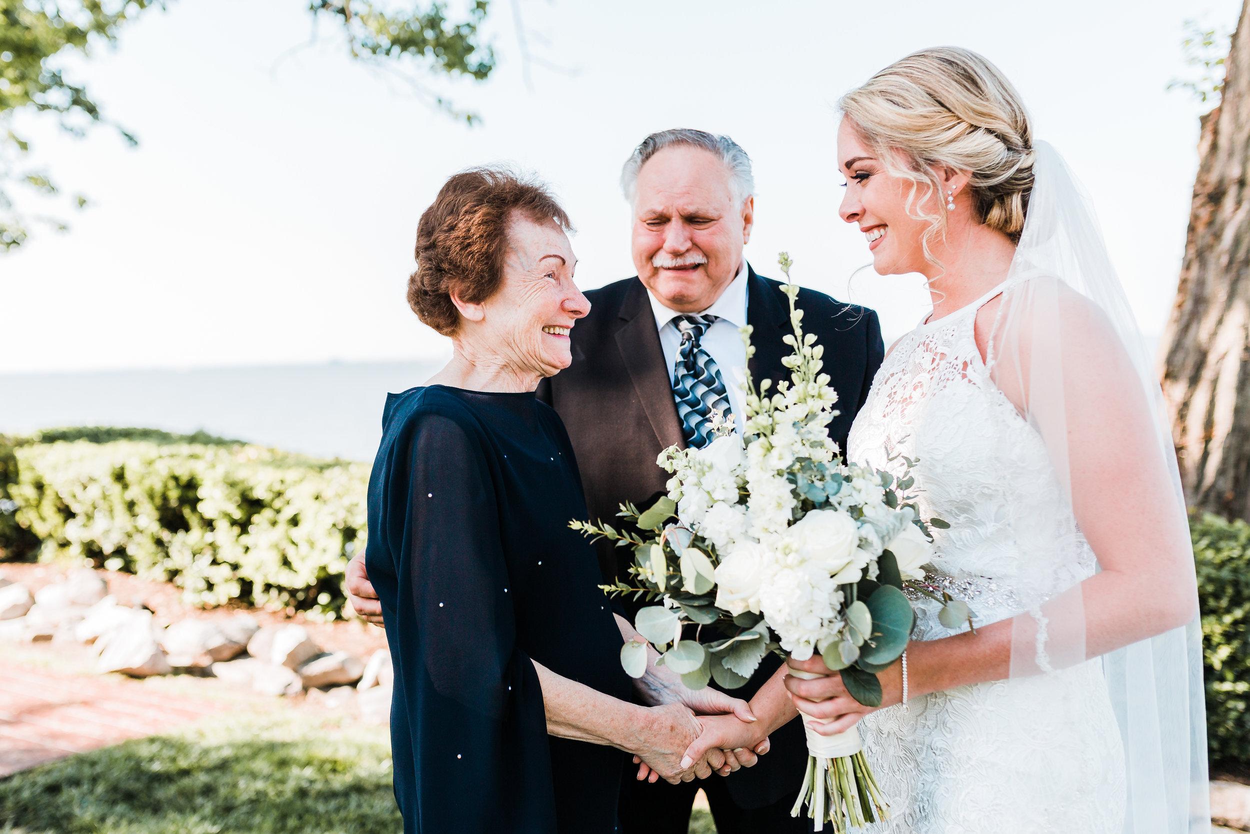 bride smiling at grandma during first look - pasadena, md - celebrations at the bay