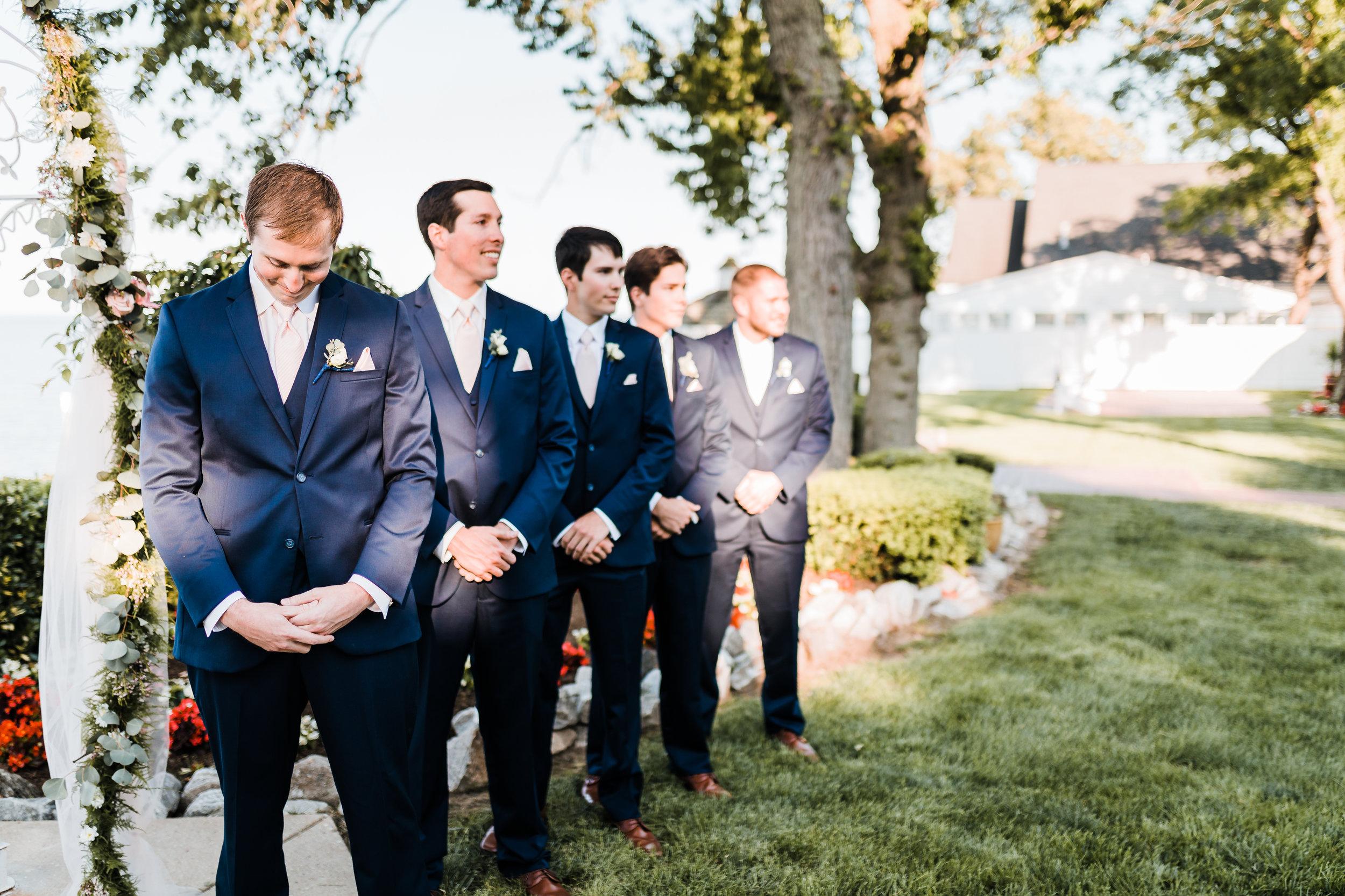 groom sees his bride walking down the aisle - groom reaction - pasadena maryland wedding photographer