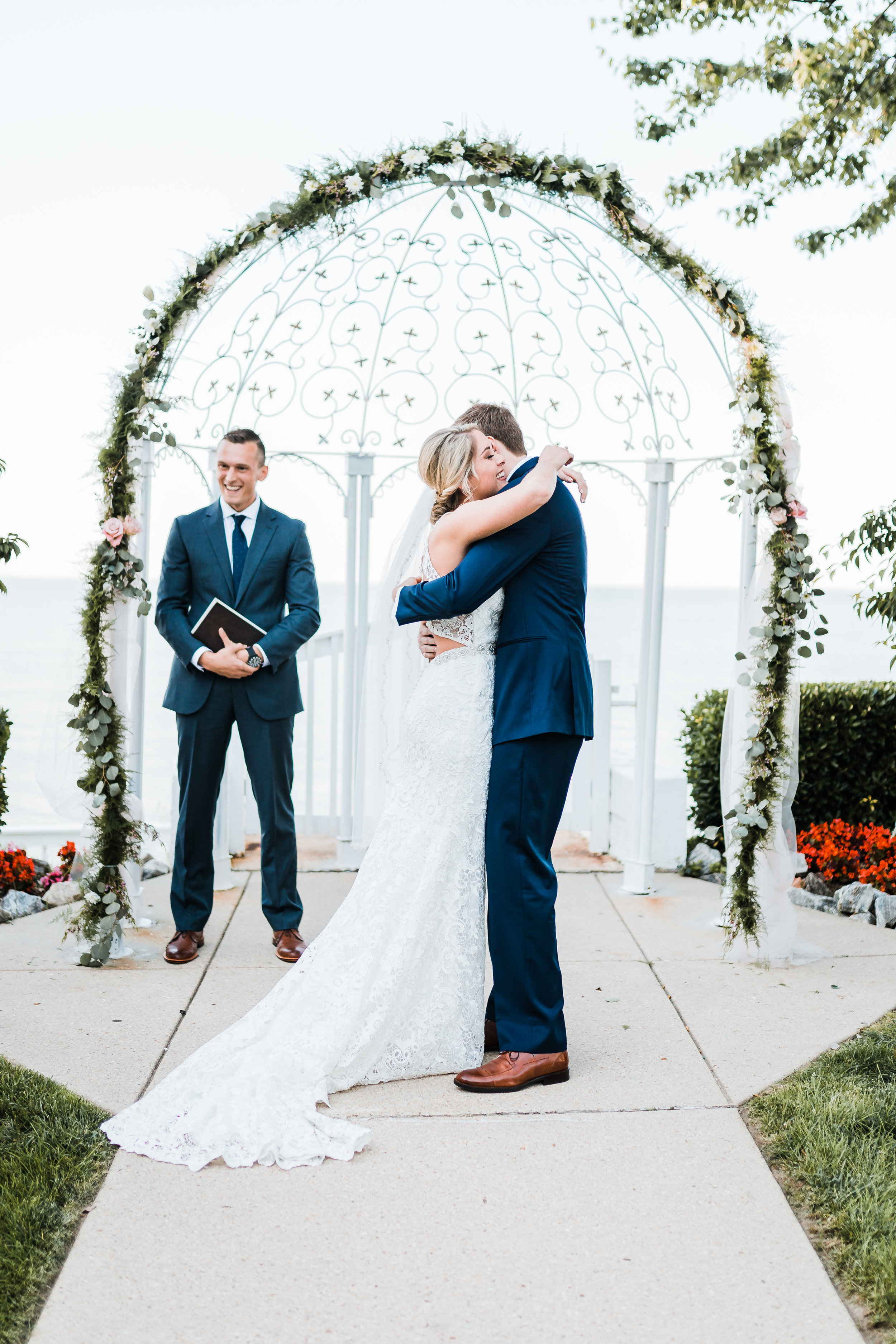 bride and groom share their first hug after kiss at celebrations at the bay