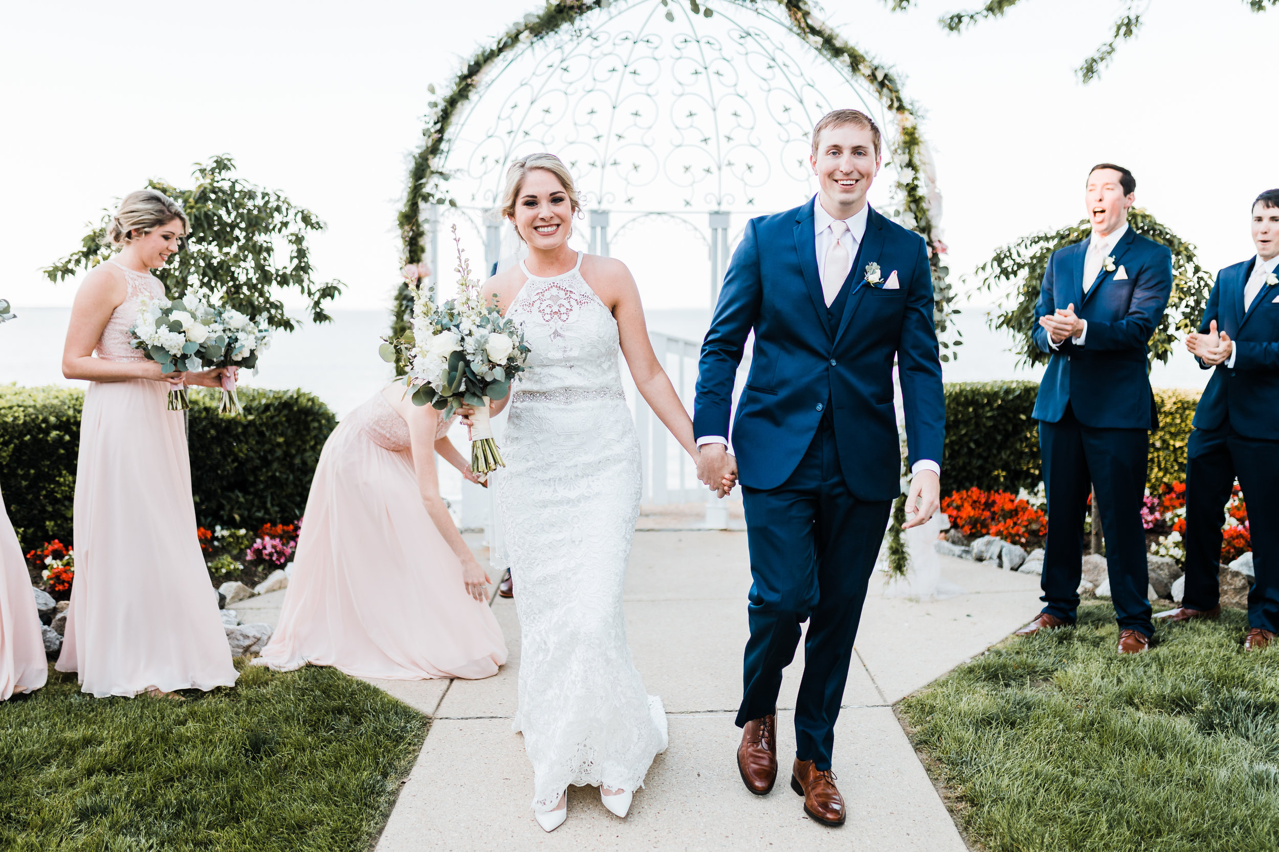 bride and groom excitedly make their way down the aisle after they said their i do's! - maryland wedding photographer