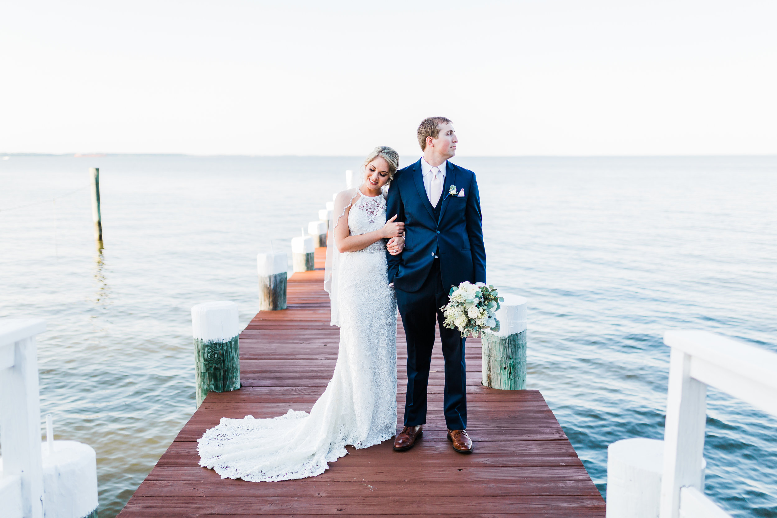bayside wedding - bride and groom standing on pier in pasadena, md - photographer