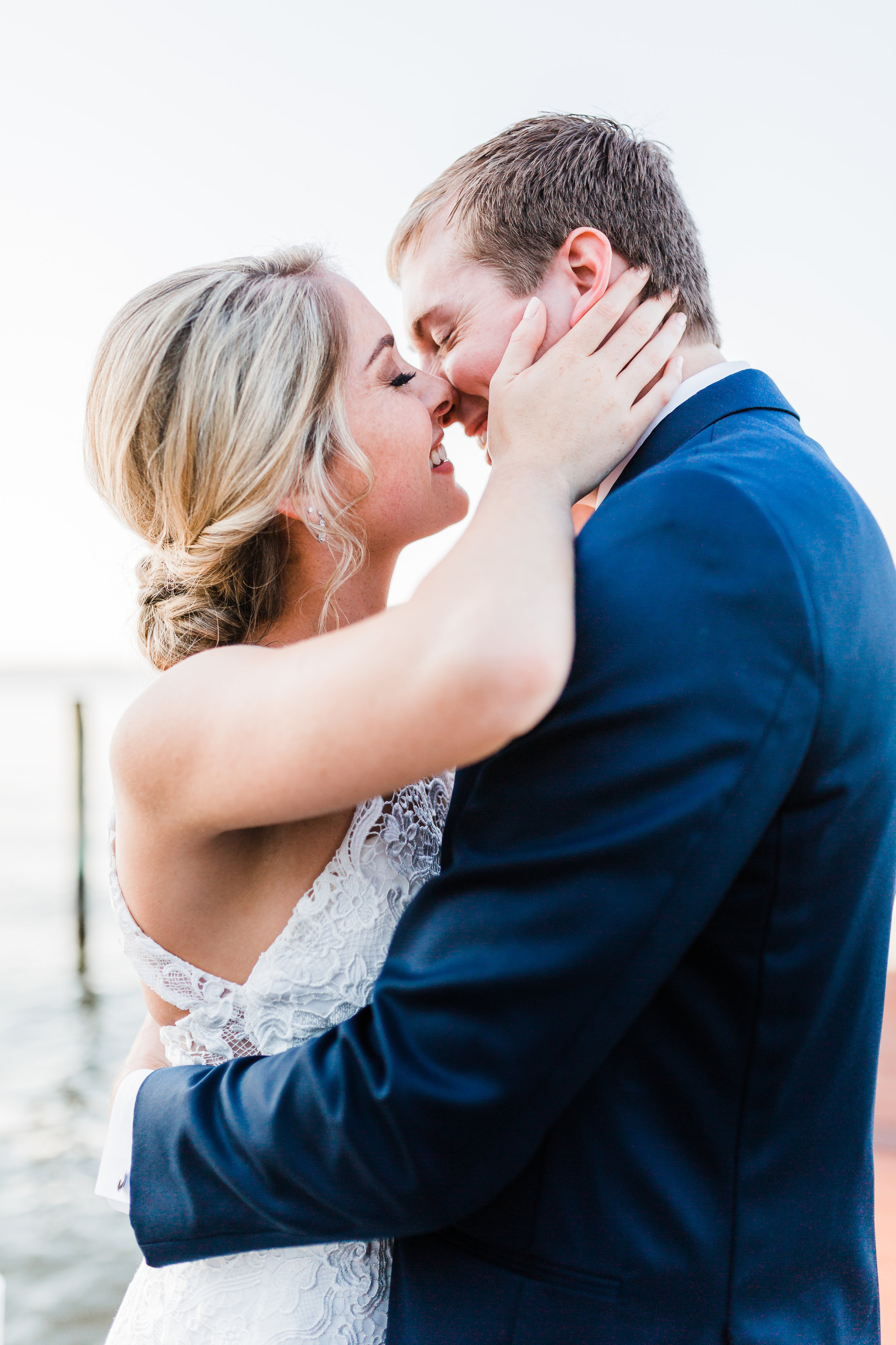 bride holds groom before she gives him a kiss - md wedding photographer and cinematographer