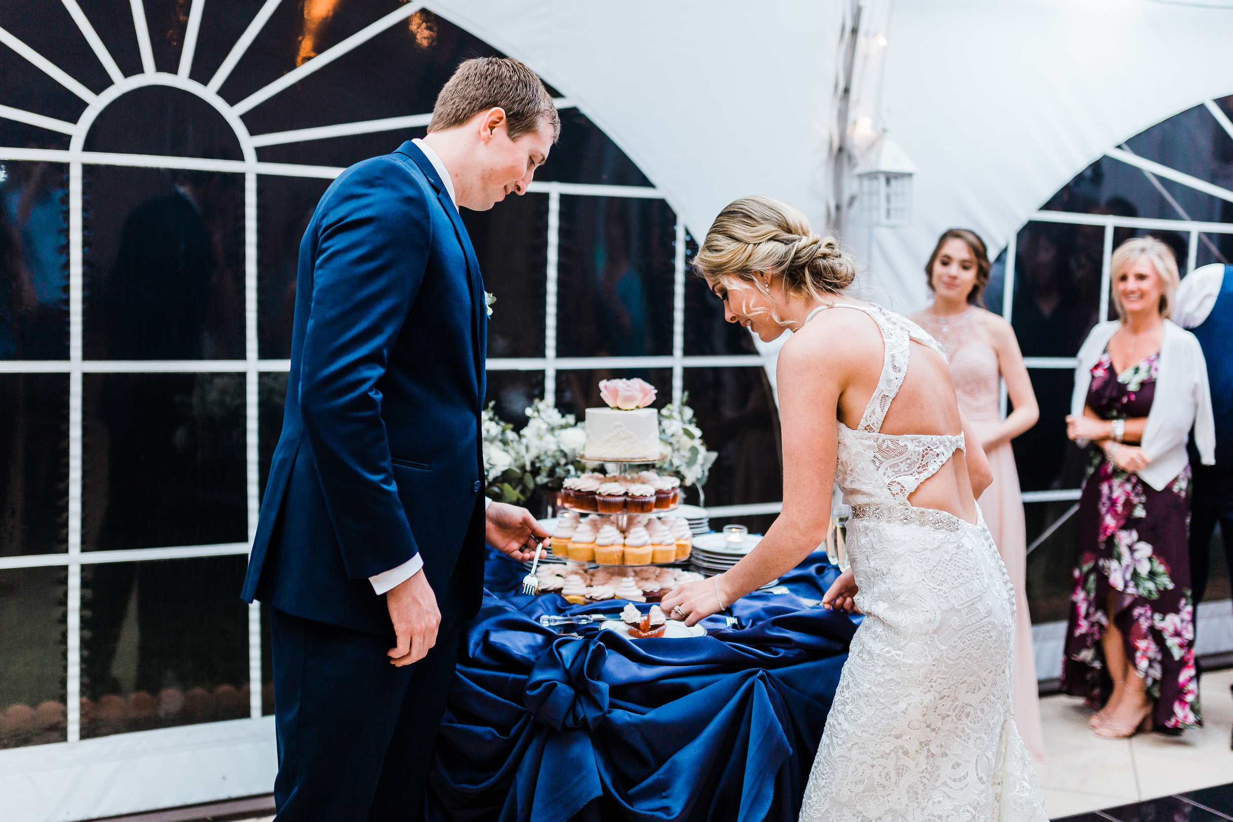 bride and groom cut their cake - maryland waterfront wedding venue