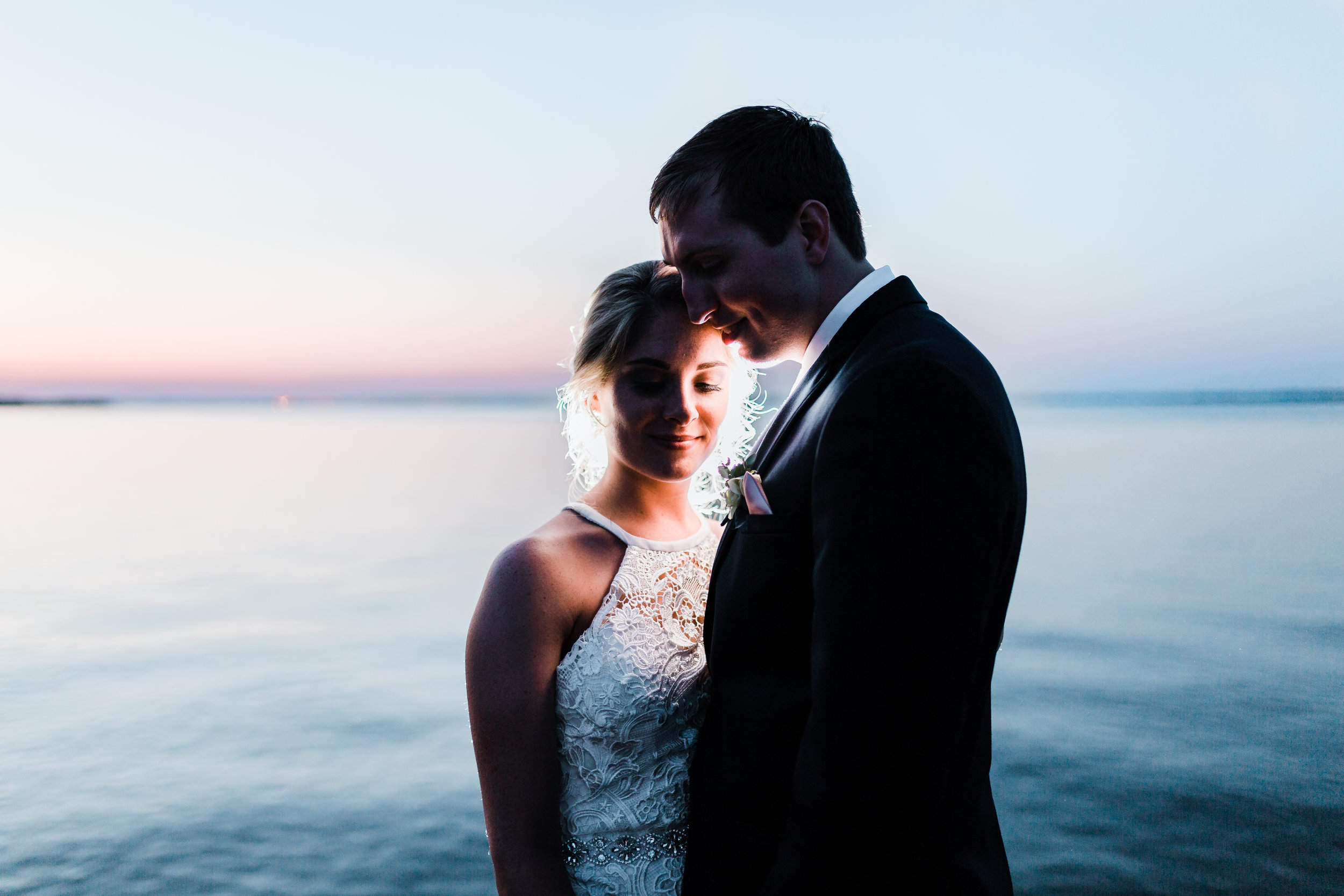 bride and groom at night by the water in maryland - md wedding venue - photographer