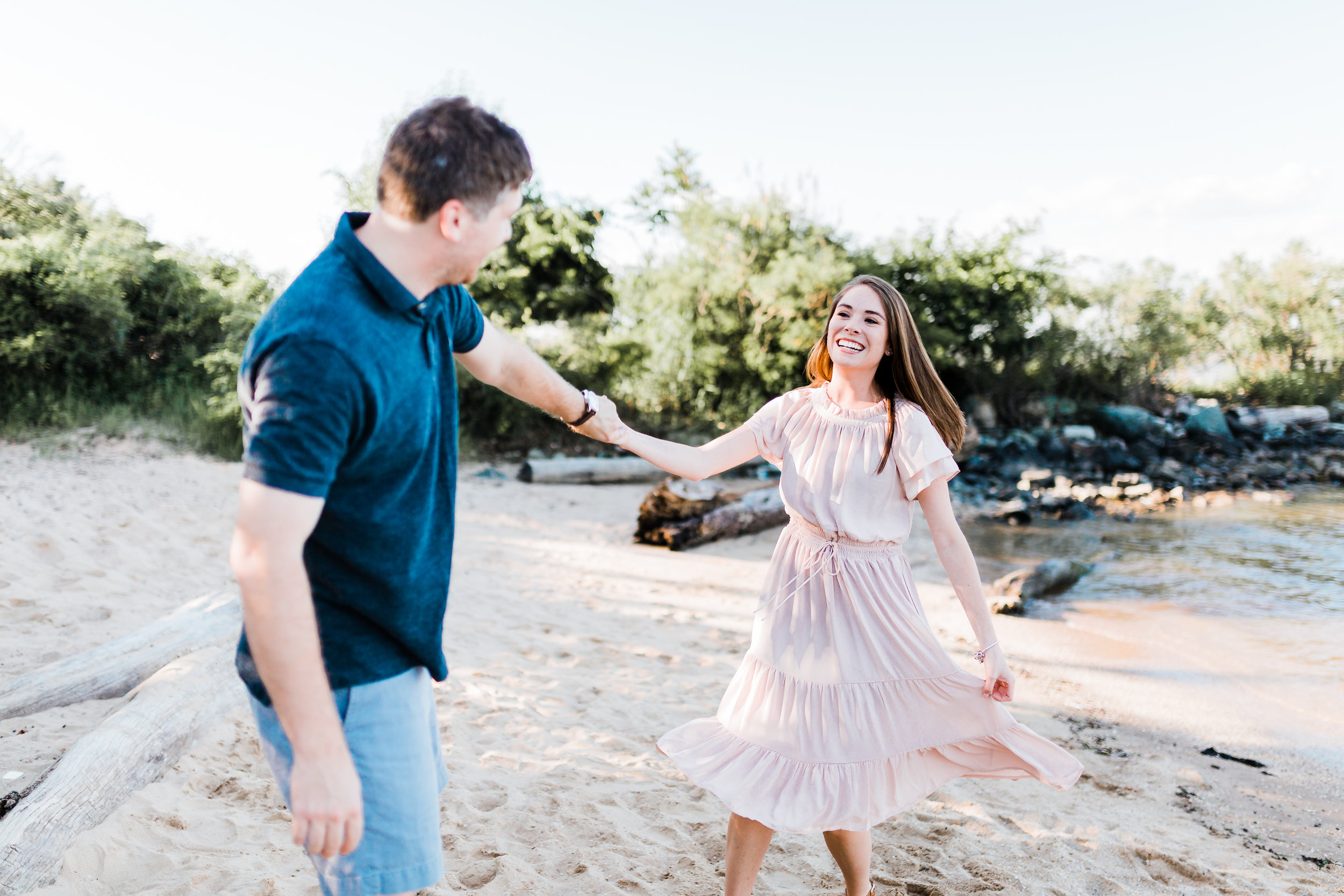 couple dancing on the beach during their engagement session in maryland - bayside - md photographer