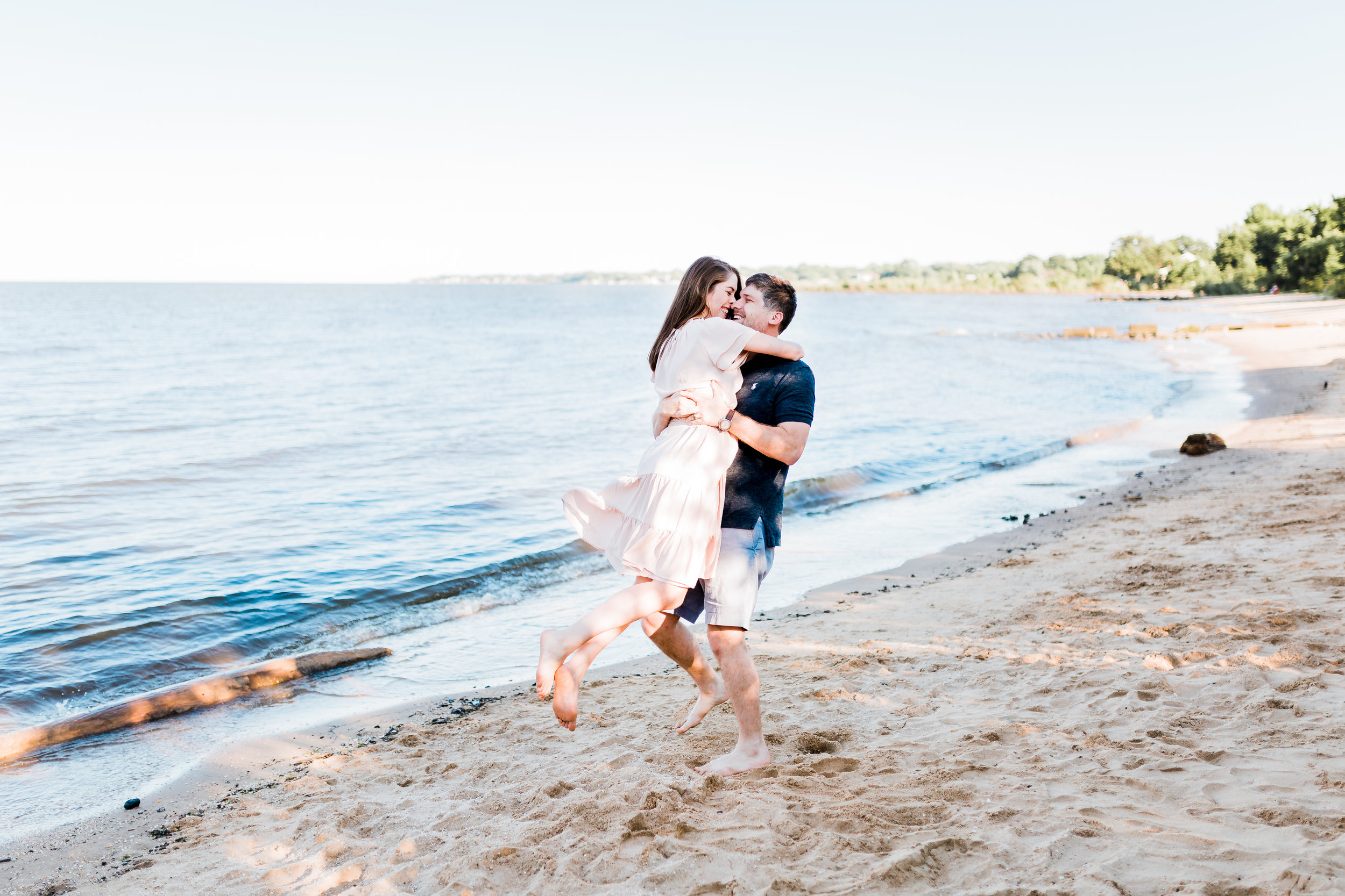 dancing during engagement session on the beach in maryland - md engagement photographer
