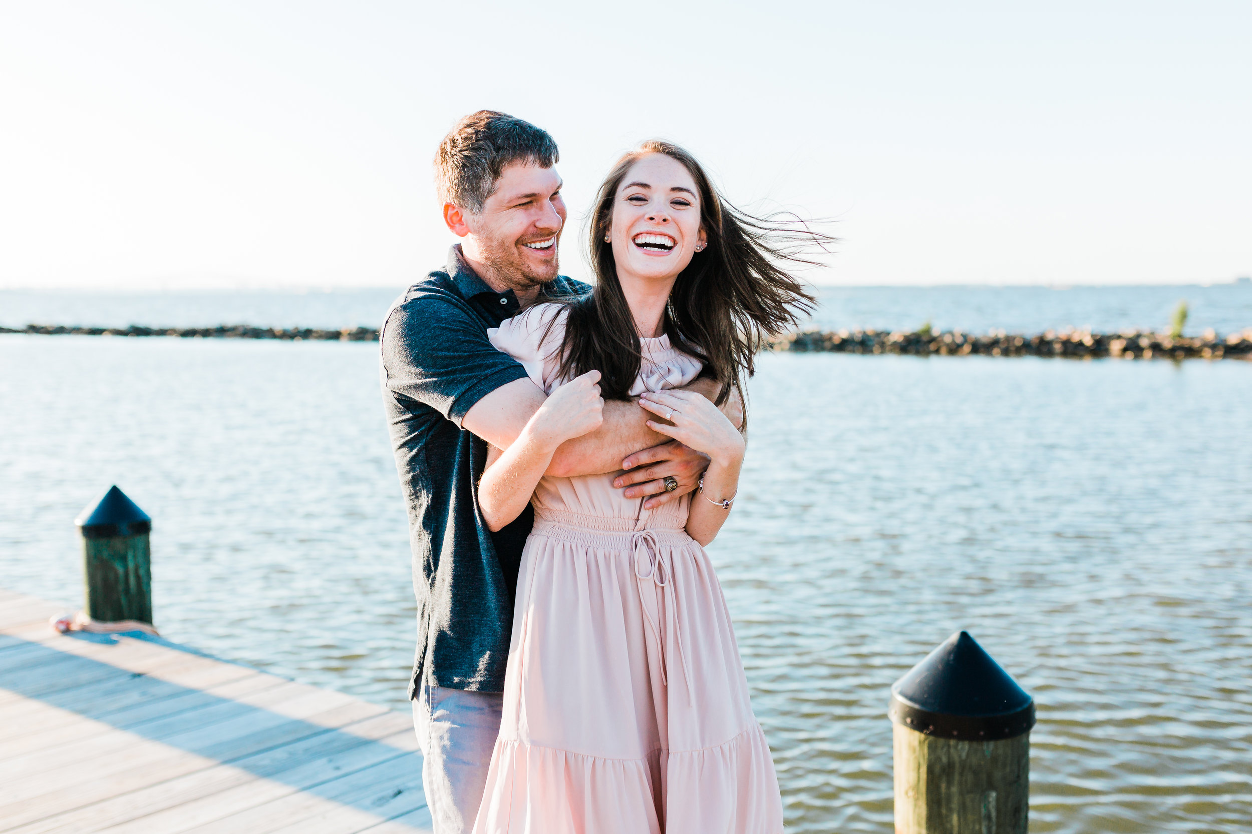 bride and groom being silly together during md engagement session - best maryland wedding photographer