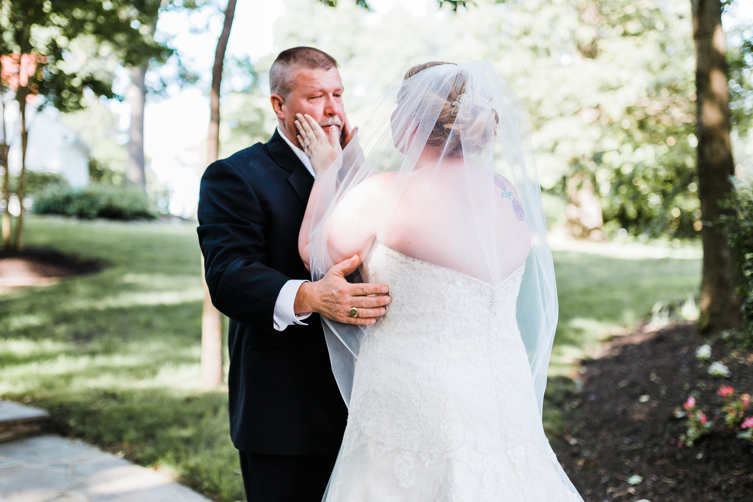 bride shares a first look with her father - maryland wedding - disney inspired wedding