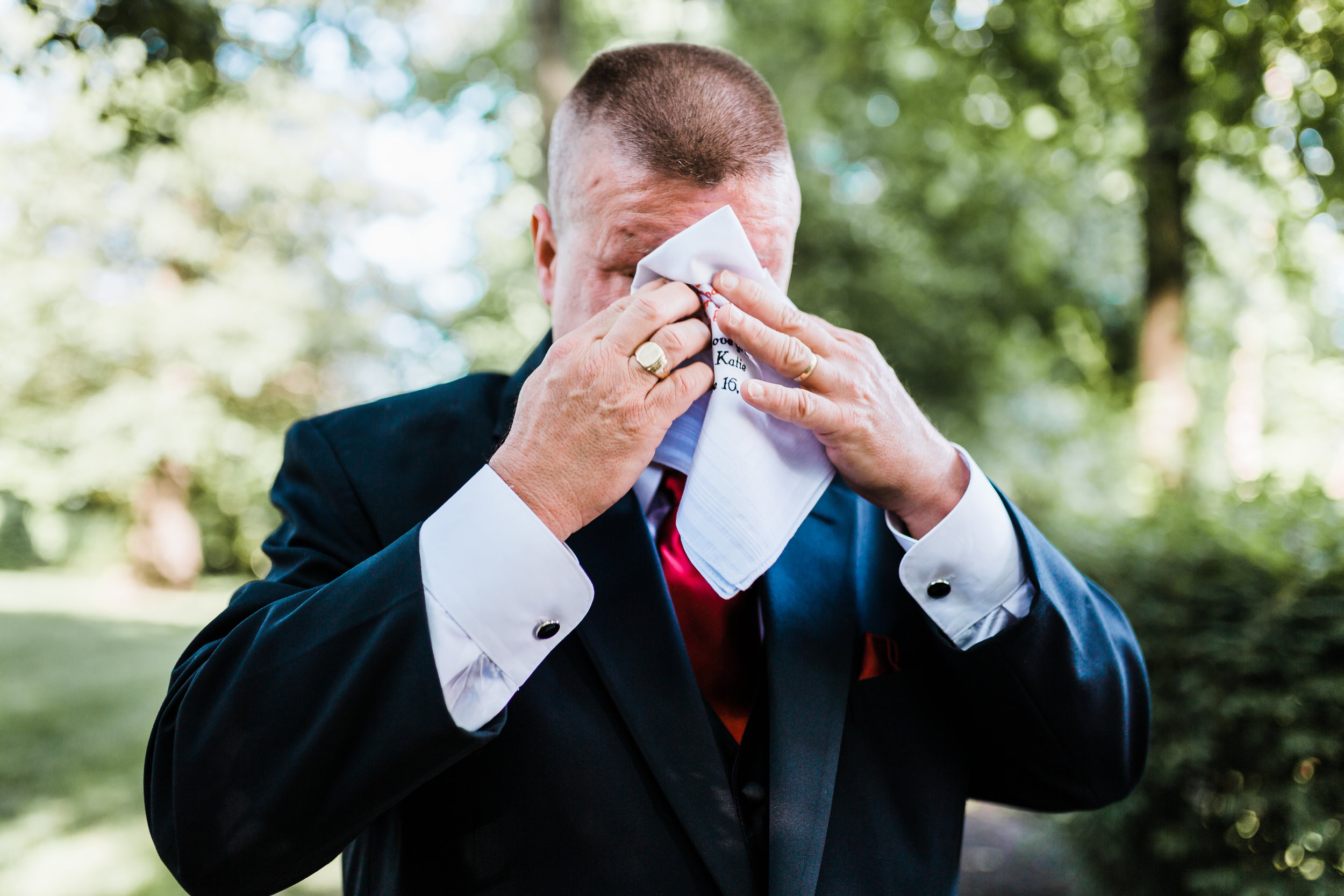father of the bride getting emotional after first look at kurtz's beach in pasadena, md - dianey inspired wedding - top md wedding photographer
