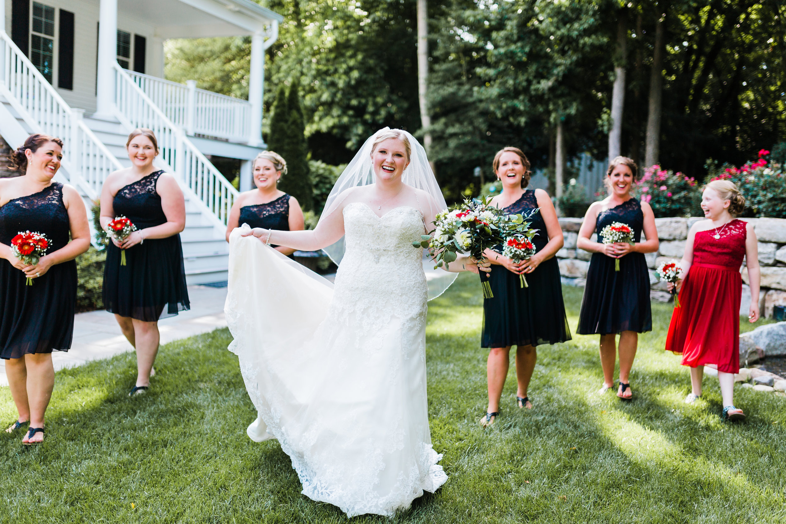 bride and bridesmaids photos - black bridesmaid dresses - red wedding bouquets and flowers - best maryland wedding photographer