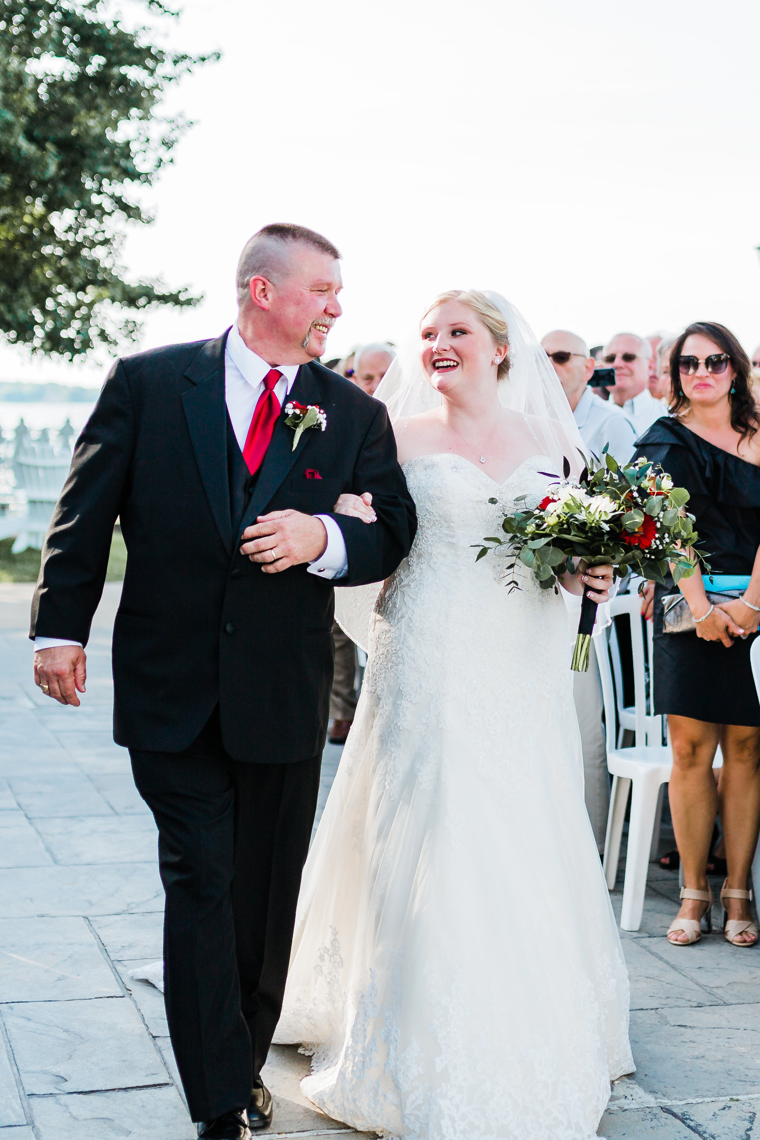 father of the bride walks his daughter down the aisle - kurtz's beach - md bayside wedding venues - best maryland wedding photographer and video