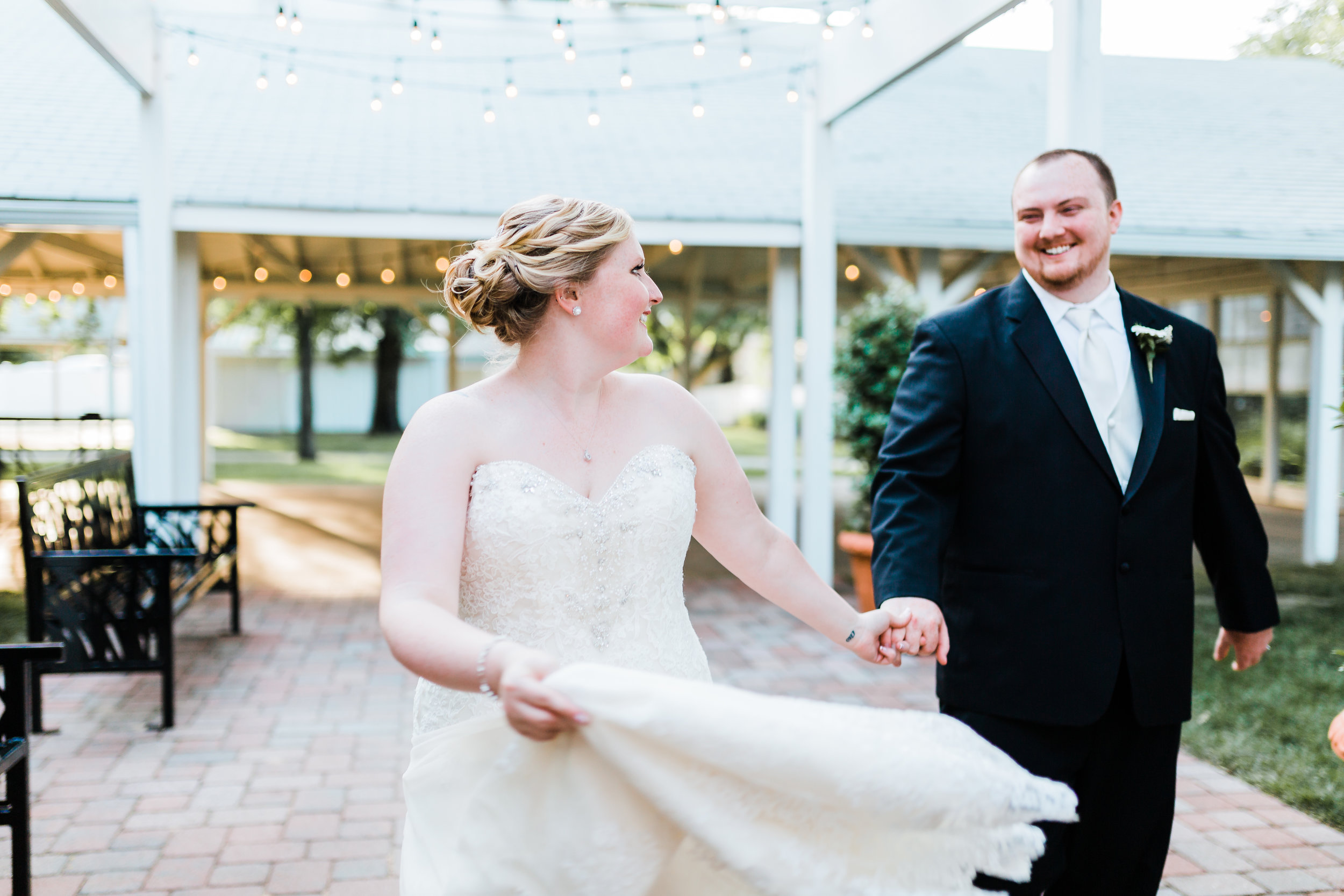 bride and groom running together and having fun - maryland wedding photographer and cinematographer