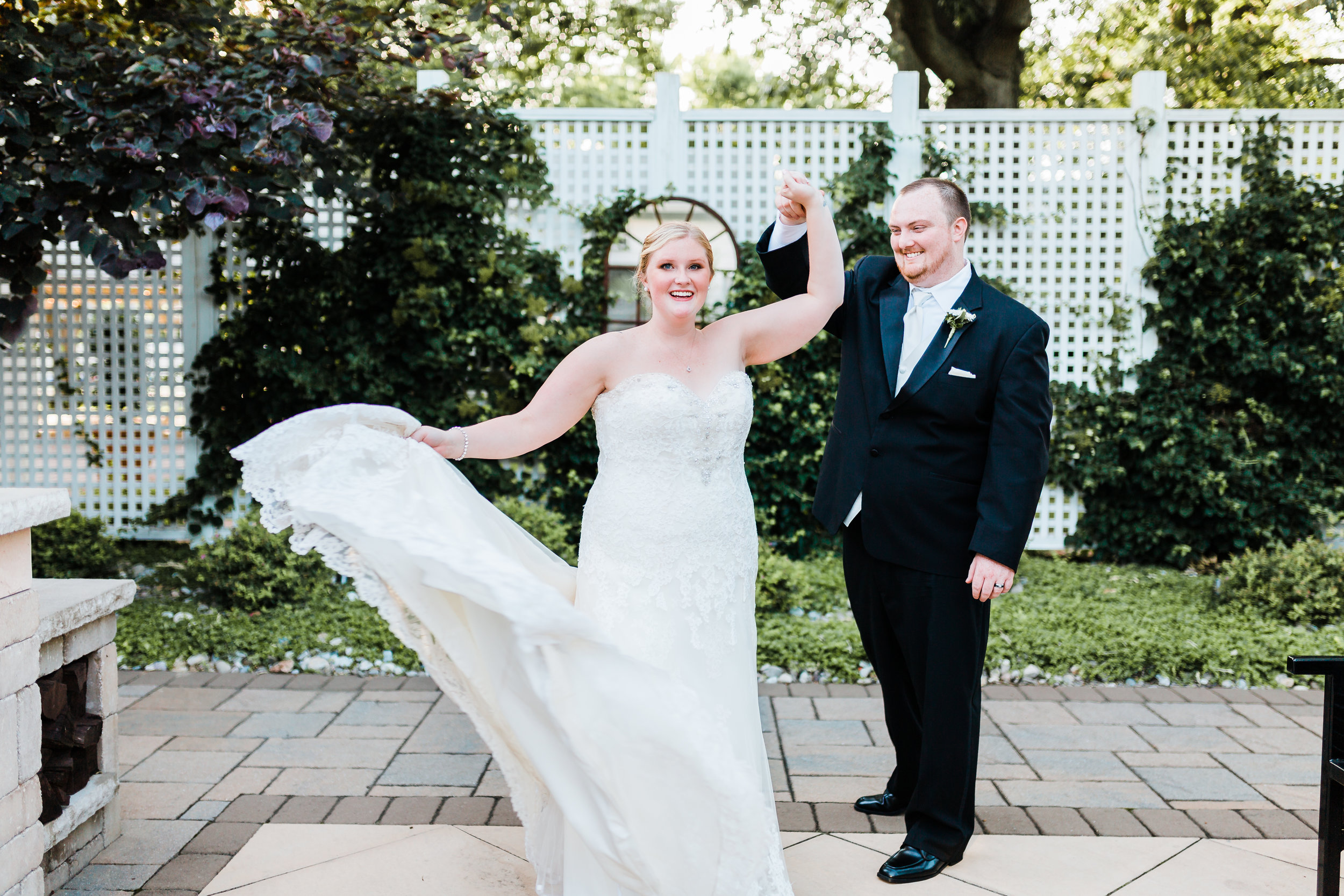 bride and groom dancing together - disney inspired wedding - red and black wedding - best md wedding photographer