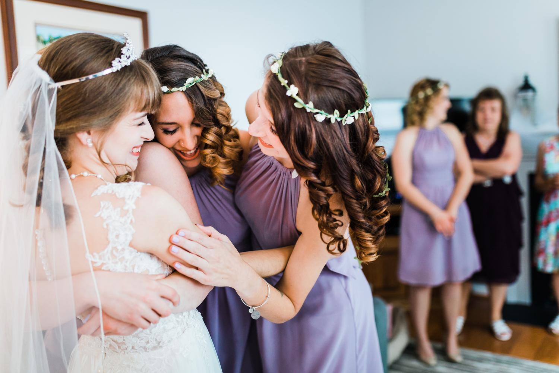 bride hugging her bridesmaids on her maryland wedding day