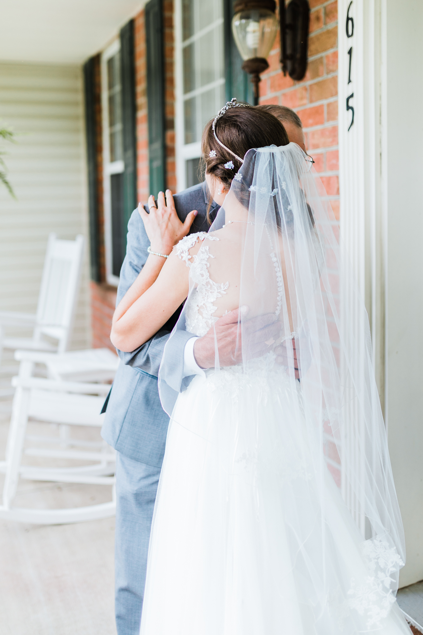 bride and father share a hug after their first look - md wedding