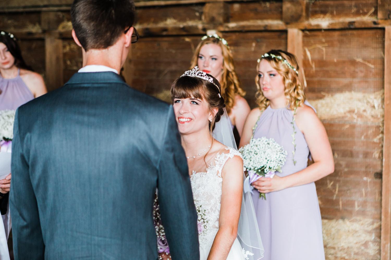 bride smiling at groom - rustic maryland wedding venues - best barn venues in maryland