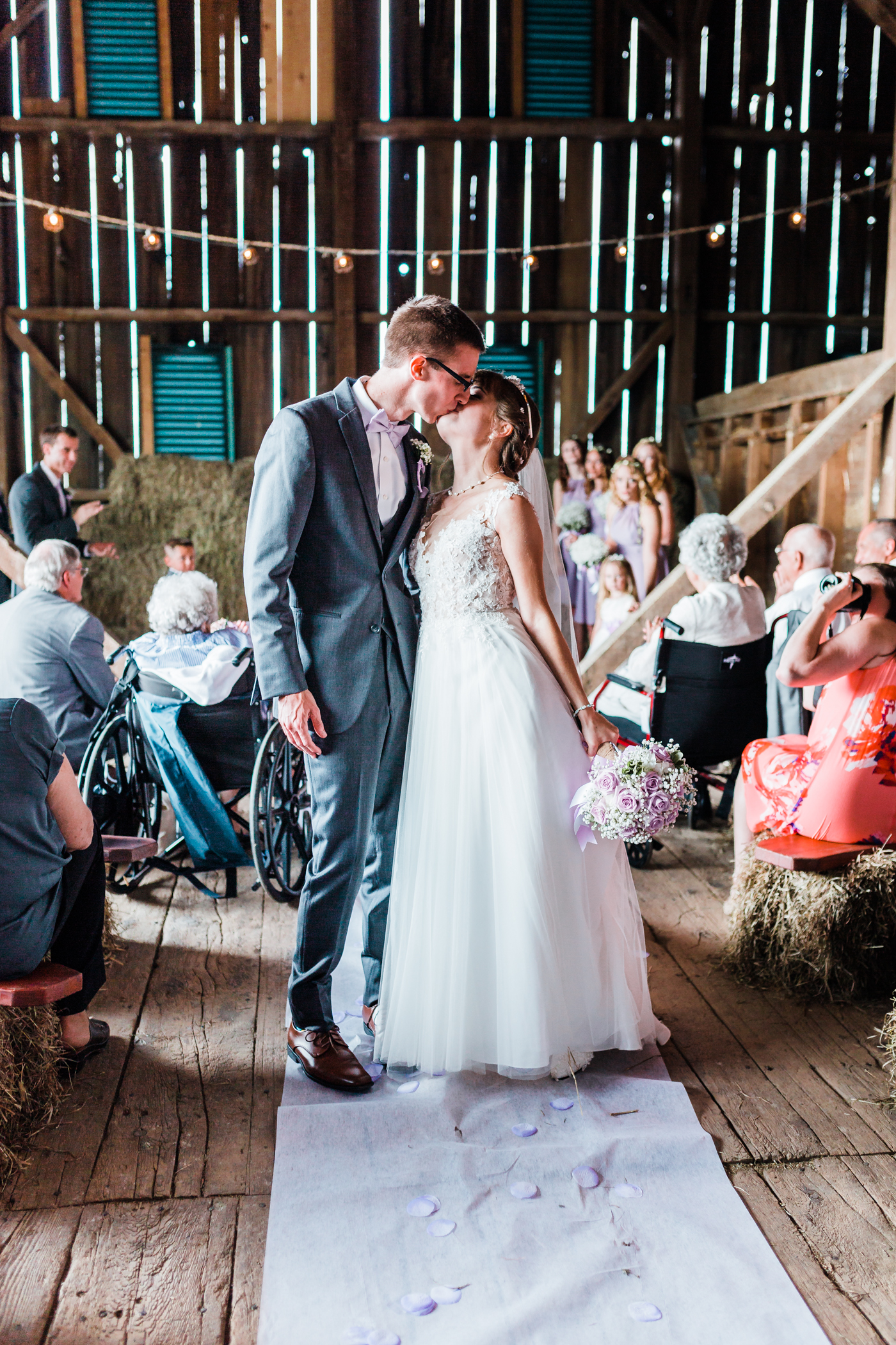 husband and wife kiss walking down the aisle - md wedding photographer and videographer