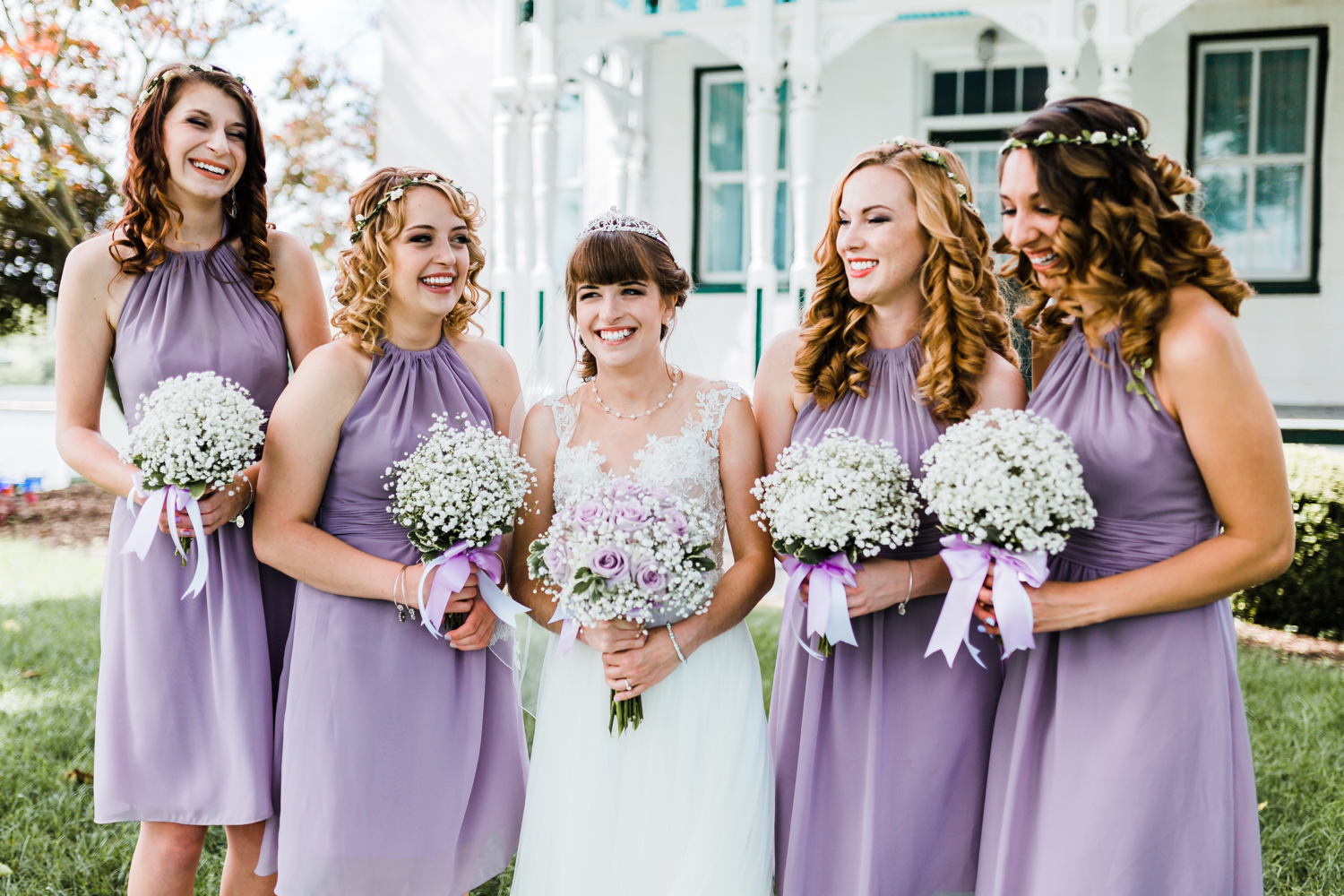 bride laughing with her bridesmaids - rustic maryland weddings