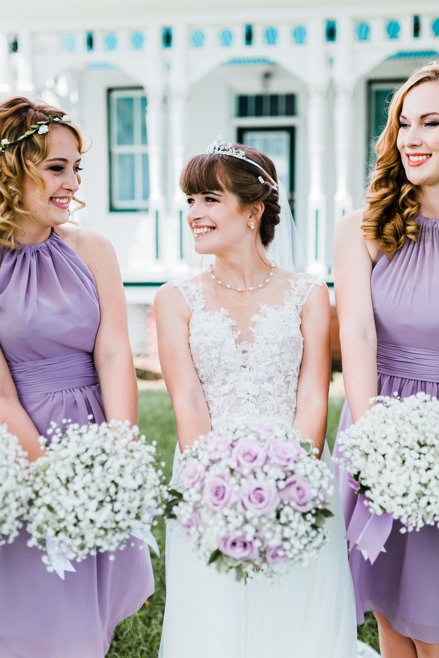 bride smiling at her maid of honor - maryland wedding venues - best md wedding photographer