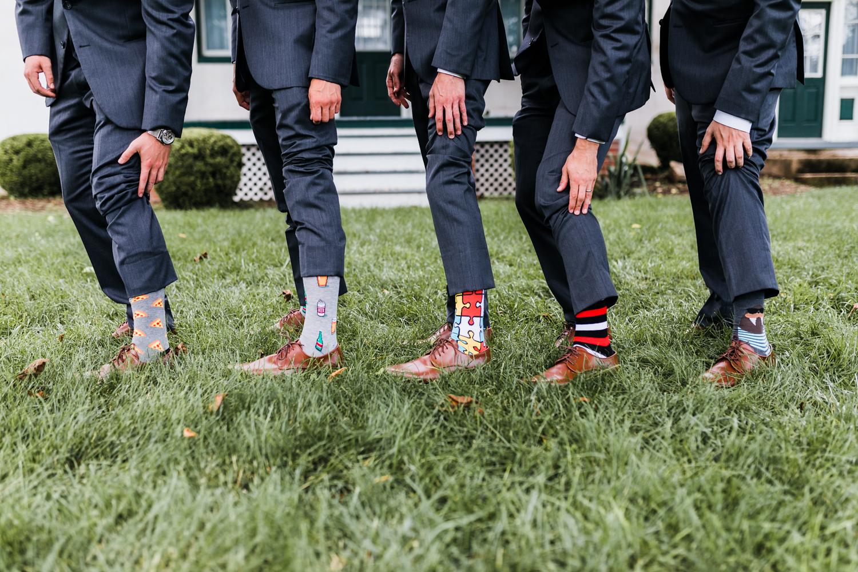 groom and groomsmen crazy unique socks for wedding day - groomsmen gift ideas - maryland wedding photographer