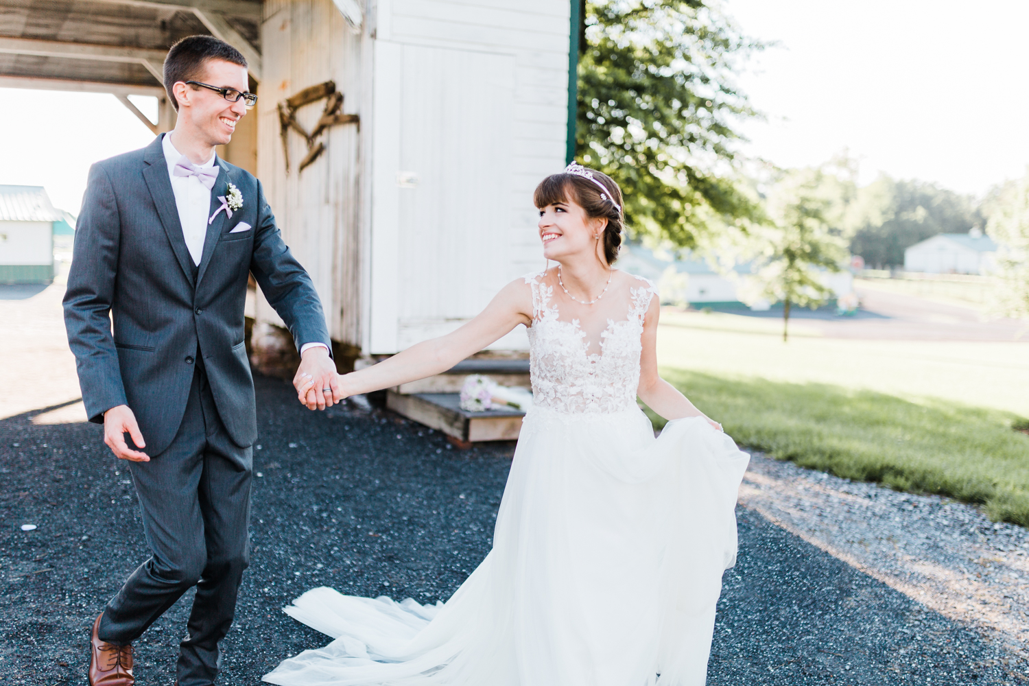 bride and groom running together and having fun at their rustic maryland wedding - best md wedding photographer