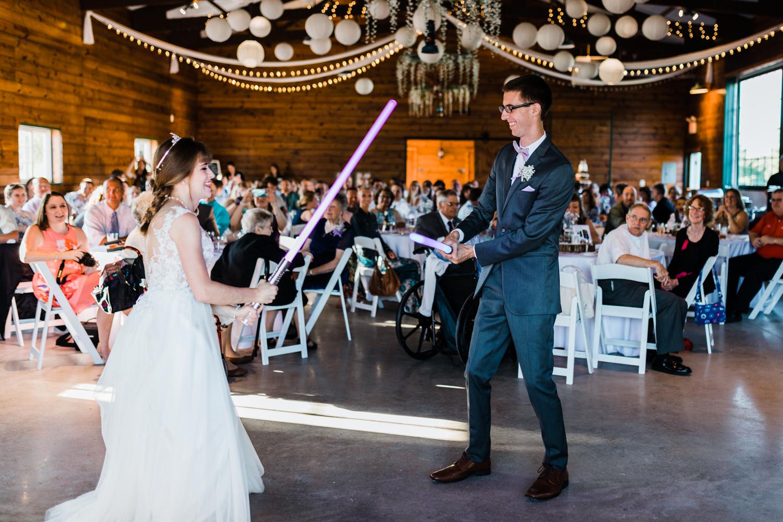 bride and groom light saber battle - star wars wedding - barn venues in maryland