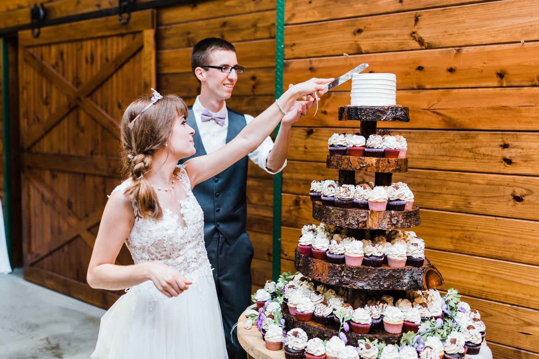 bride and groom cutting their cake - maryland barn wedding venue