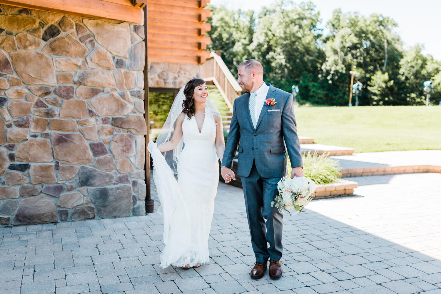 bride and groom walking happily together - log cabin weddings - mountain wedding inspo - maryland wedding venues - pennsylvania wedding venues
