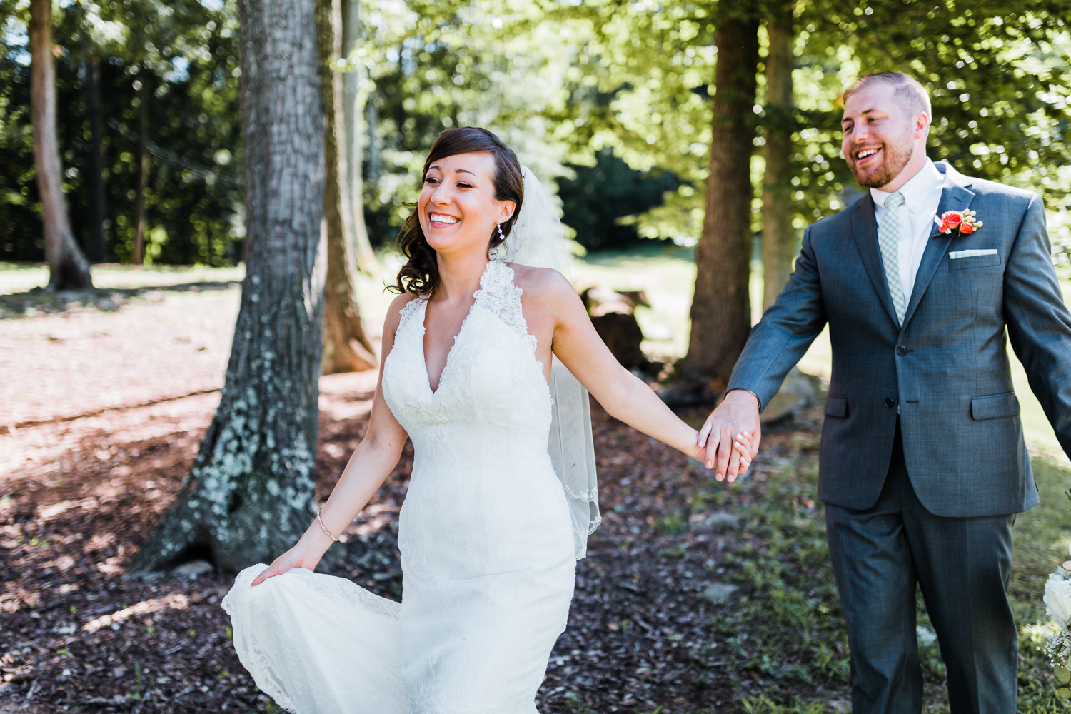 couple laughing and holding hands - PA mountain weddings