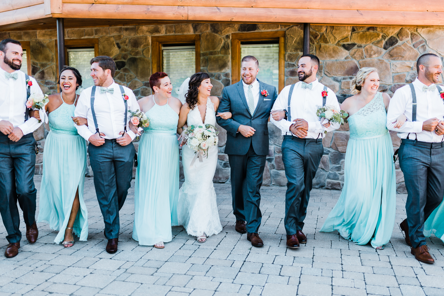 bridesmaids and groomsmen laughing with bride and groom during photos - maryland wedding photographer - best overall experience