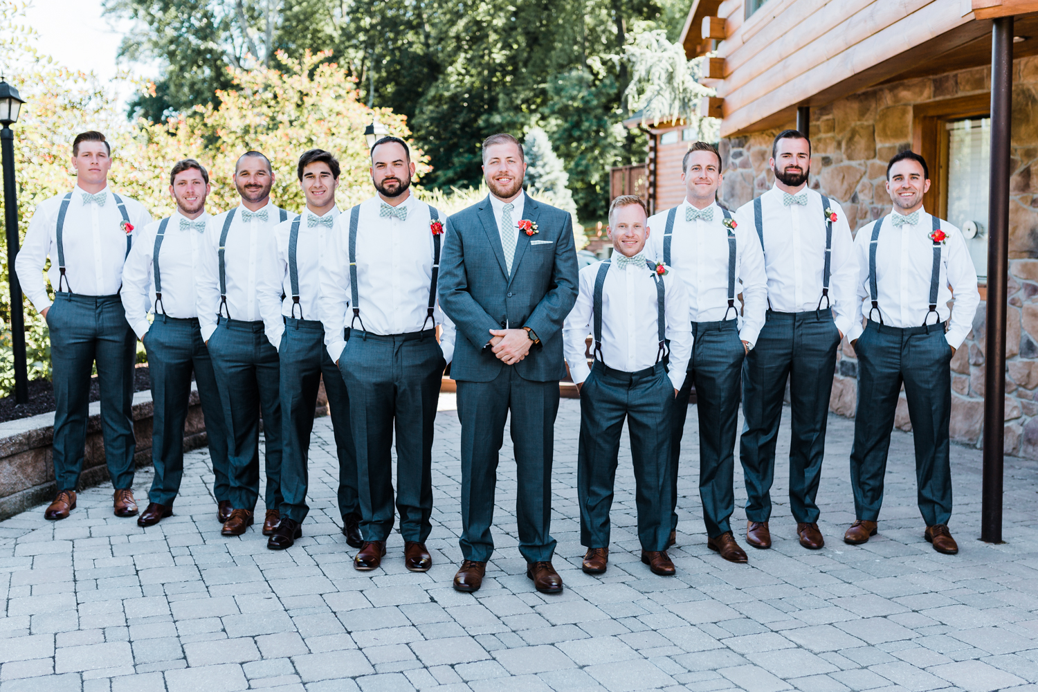 groom with his groomsmen - suspenders at wedding - mountain weddings - large party of groomsmen