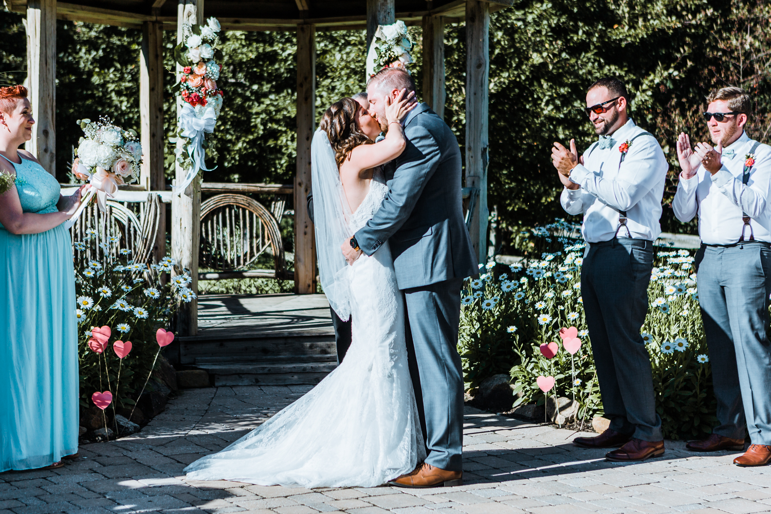 bride and groom share their first kiss as husband and wife - boulder lodge - Liberty Mountain Resort