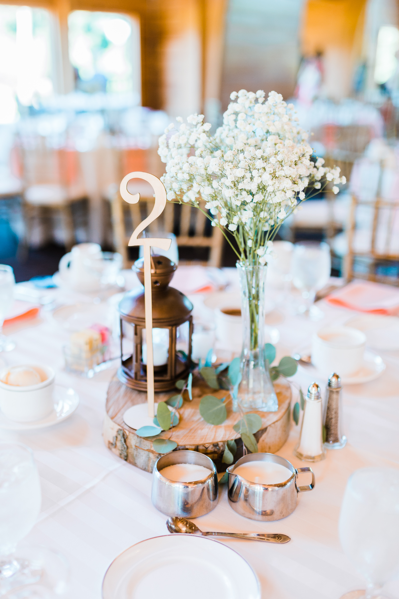 simple rustic centerpieces - reception details - wood slices