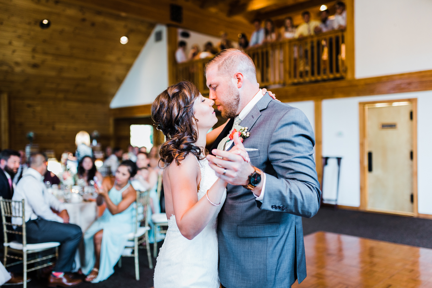 bride and groom share their first dance with a romantic moment