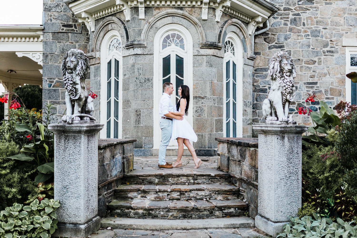 beautiful couple on the steps at cylburn arboretum for their engagement photos