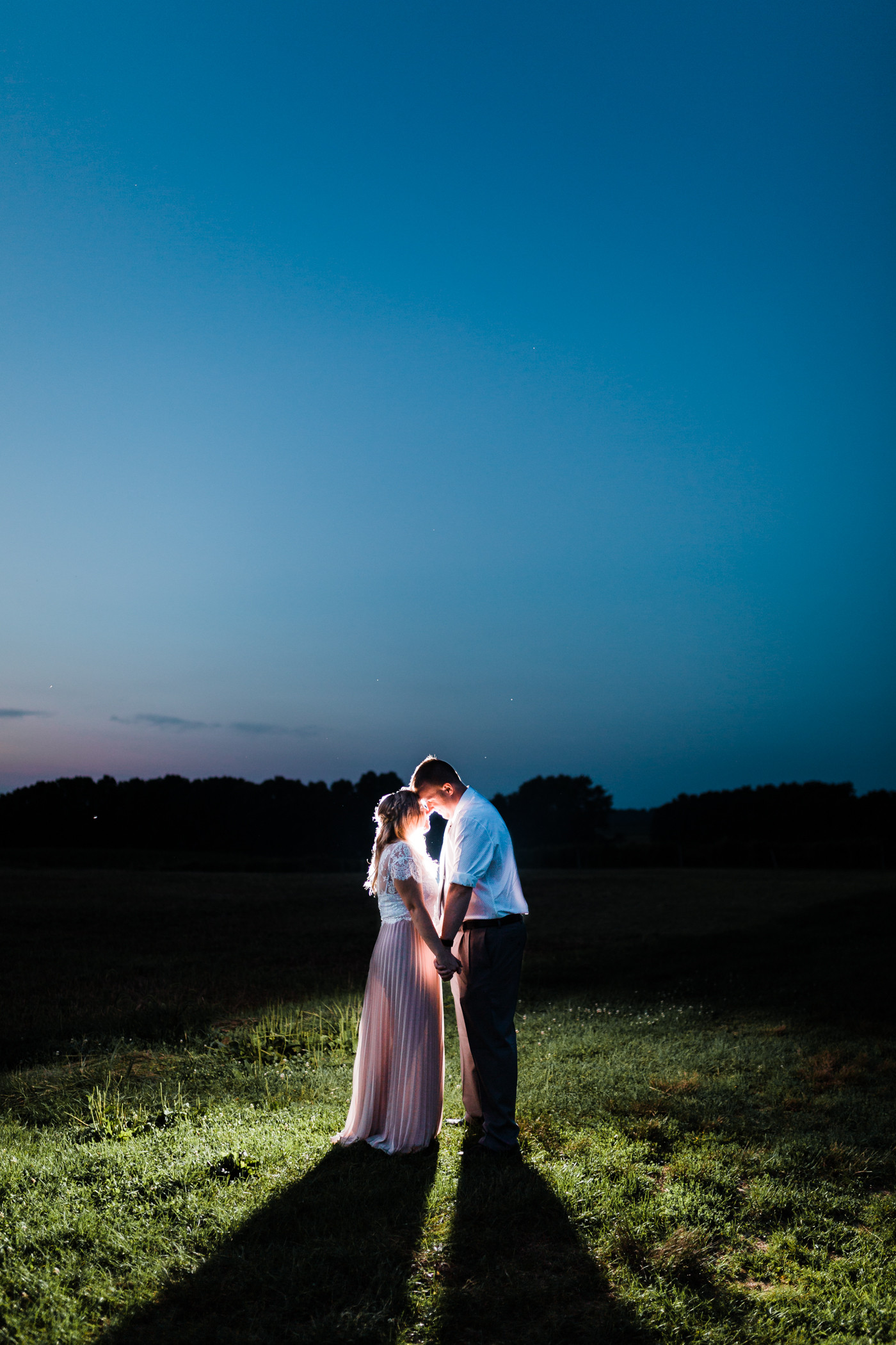 romantic night photo of bride and groom during engagement session