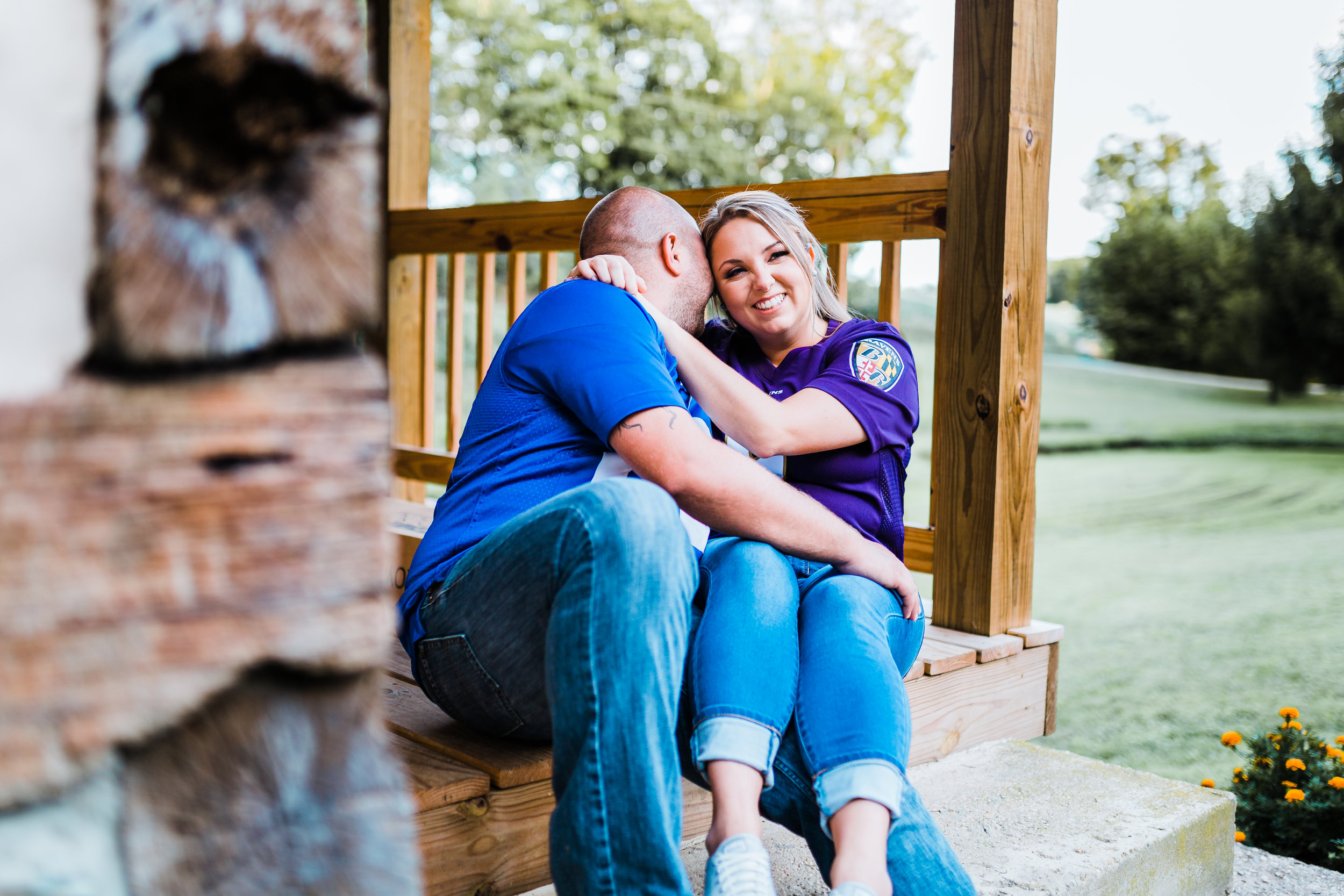 couple snuggling on porch together at westminster md engagement session