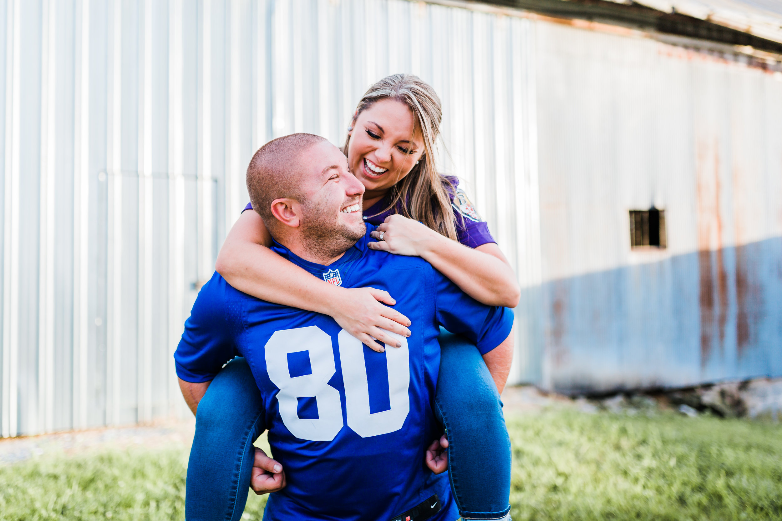 adorable couple - groom giving bride a piggyback - fun engagement photo ideas