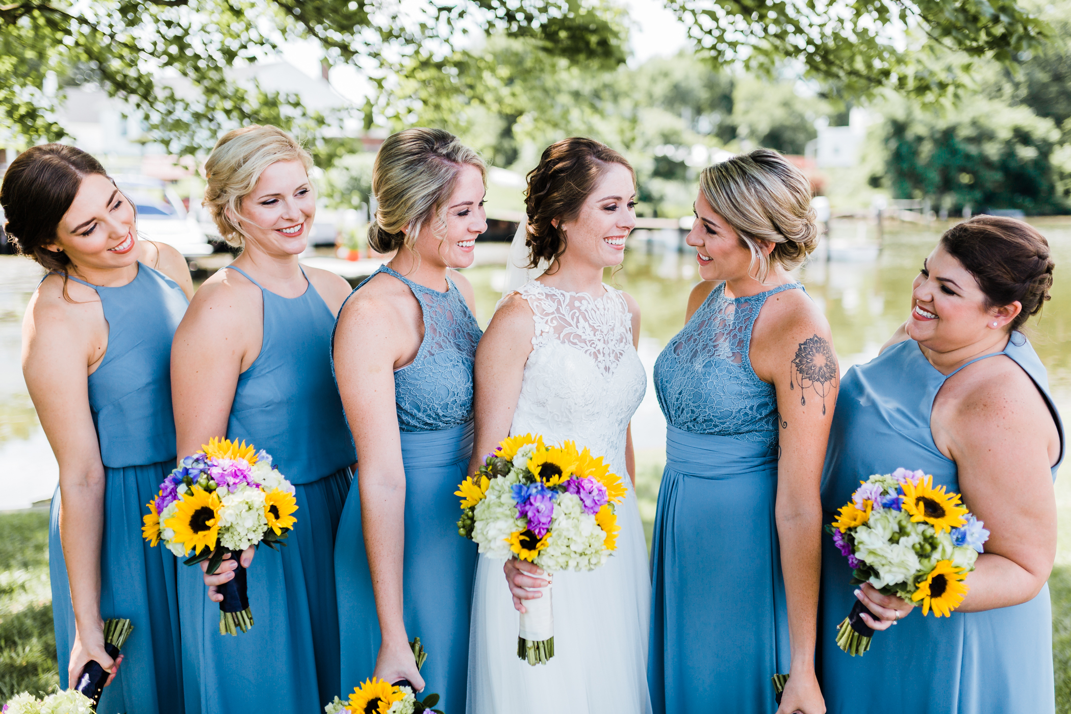 blue bridesmaid dresses and sunflower bouquets - maryland wedding photographer