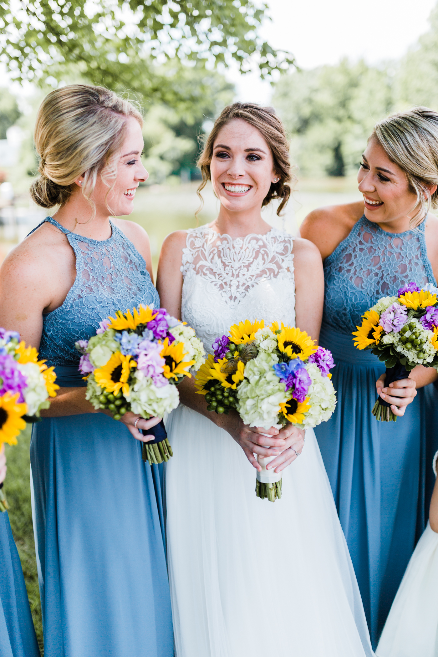 beautiful bride smiling with her bridesmaids - md wedding photographer