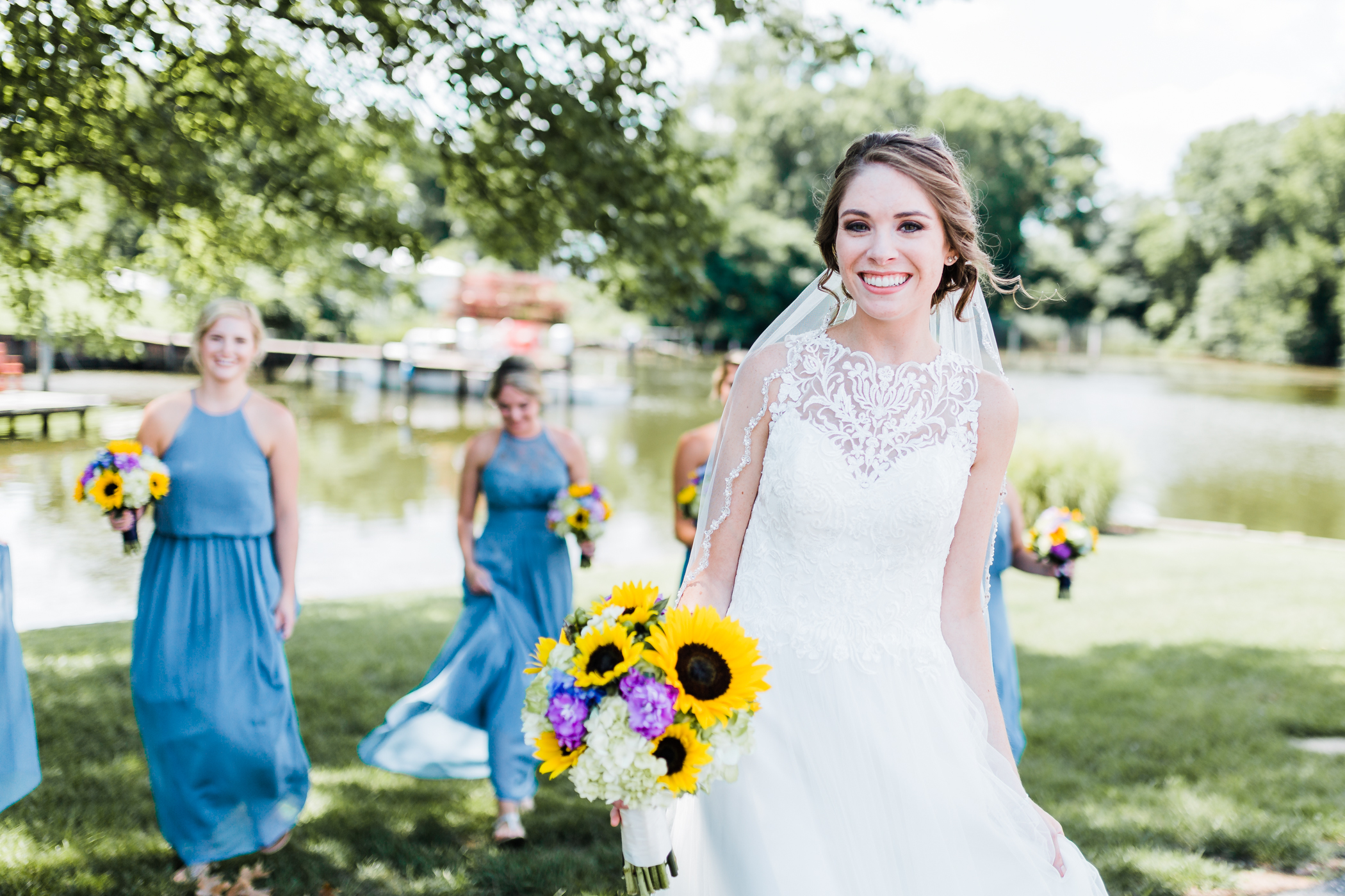 blue bridesmaid dresses - sunflower wedding bouquets - wedding inspiration