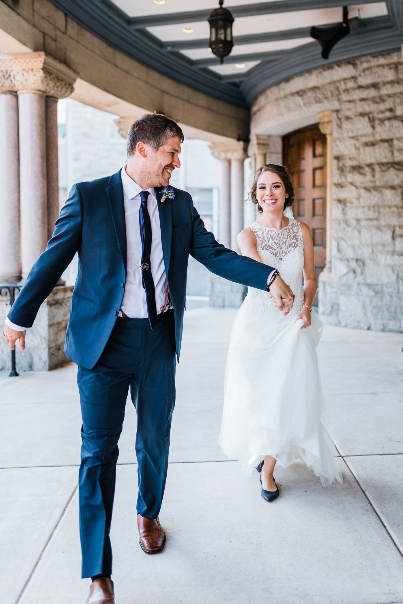 bride and groom having fun on their wedding day - husband and wife photography and videography team in maryland