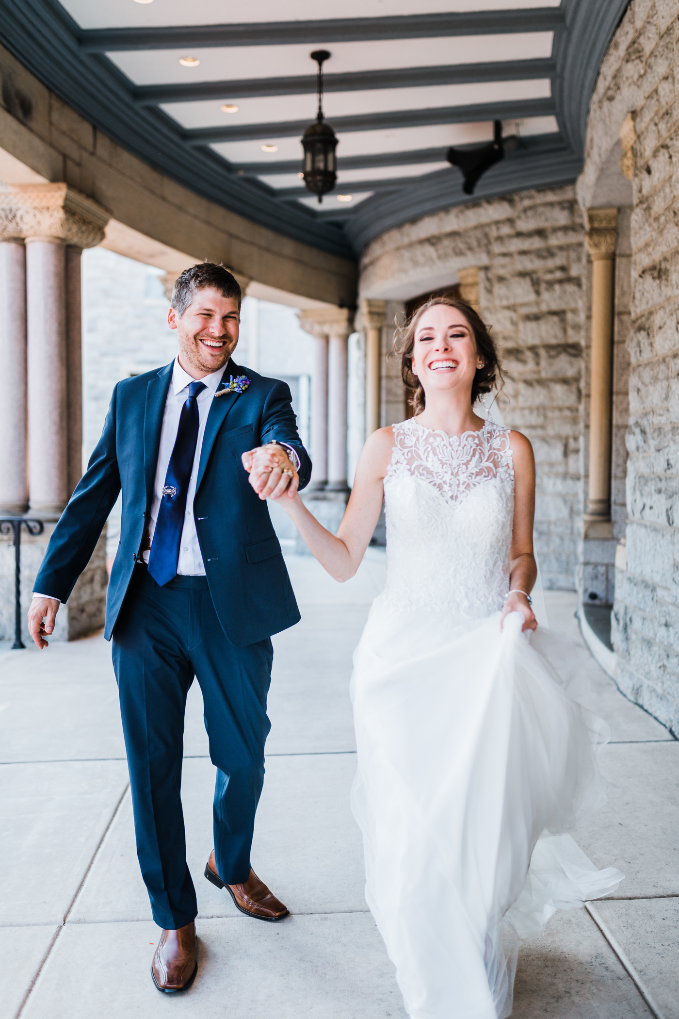 bride and groom laughing on their wedding day in baltimore md - best maryland wedding photographer and cinematographer