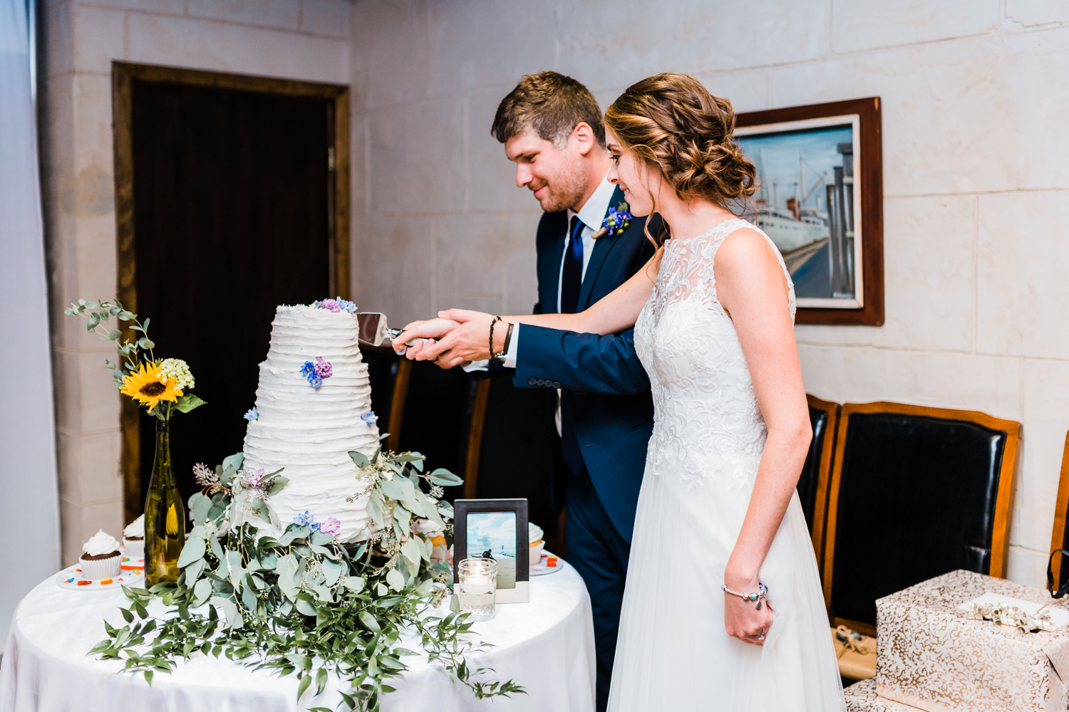 bride and groom cutting their cake - greek restaurants in baltimore