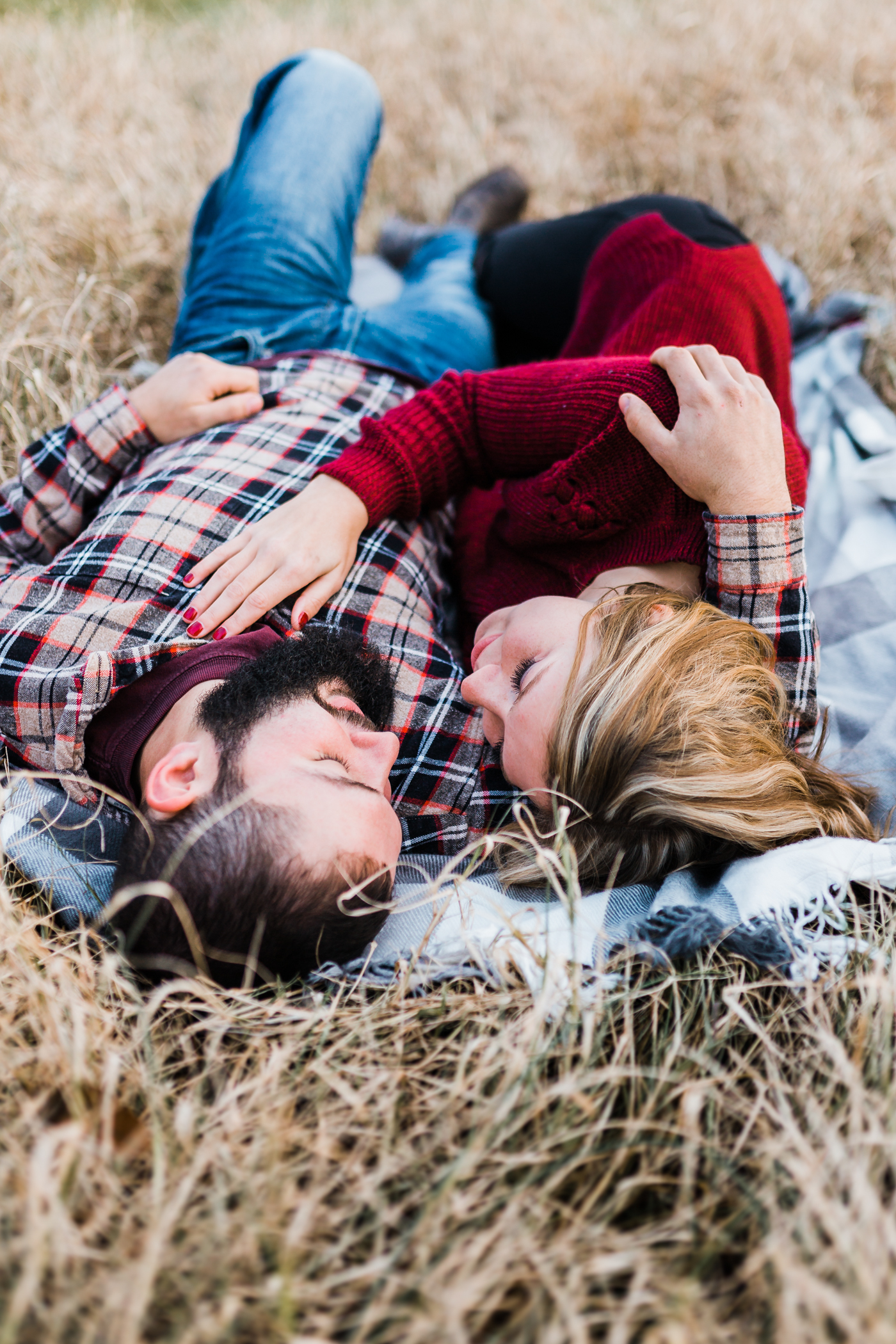 laying down engagement pose ideas - Maryland wedding and engagement photographer and videographer