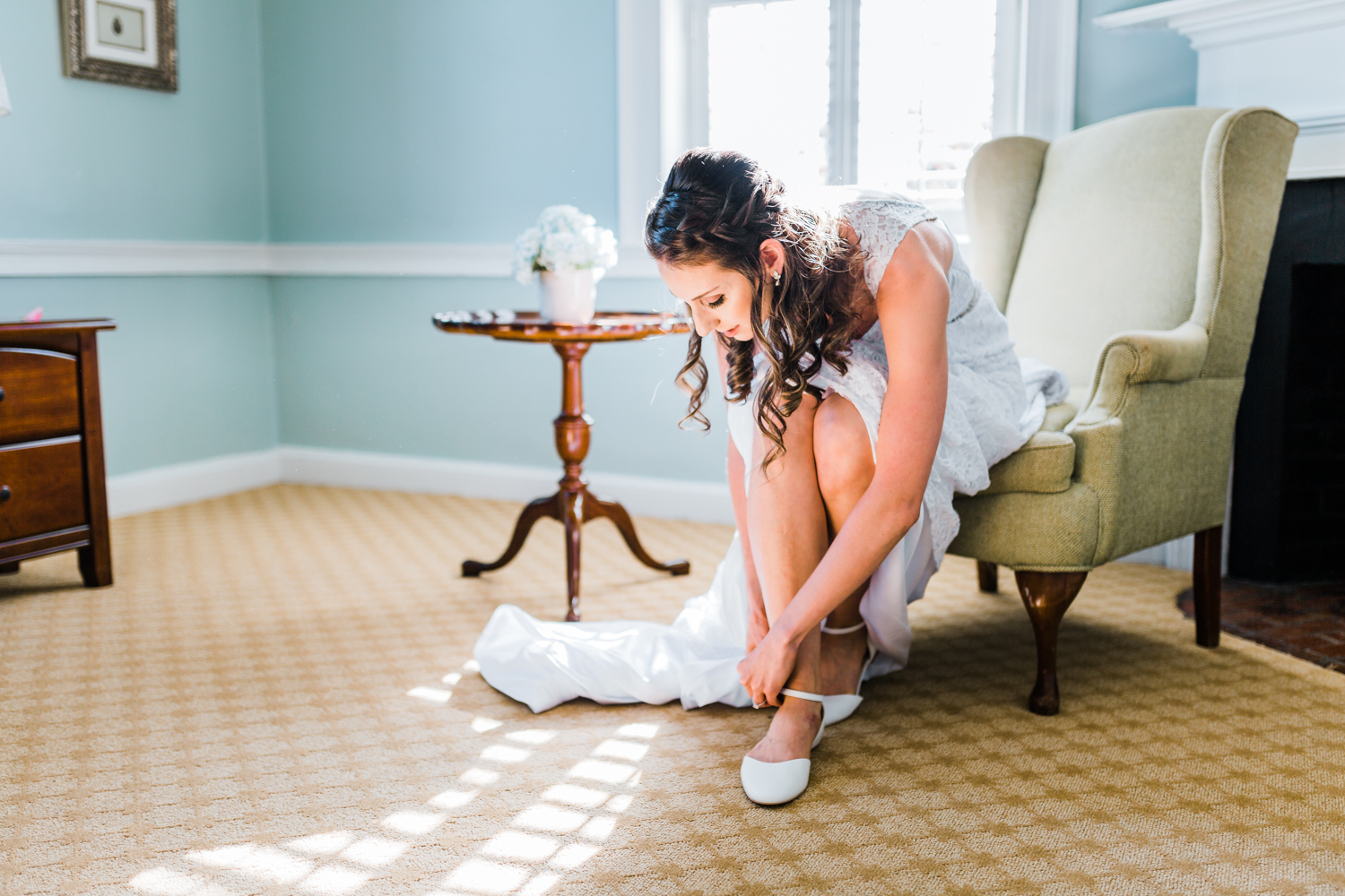 bride putting her shoes on in her bridal suite in Maryland