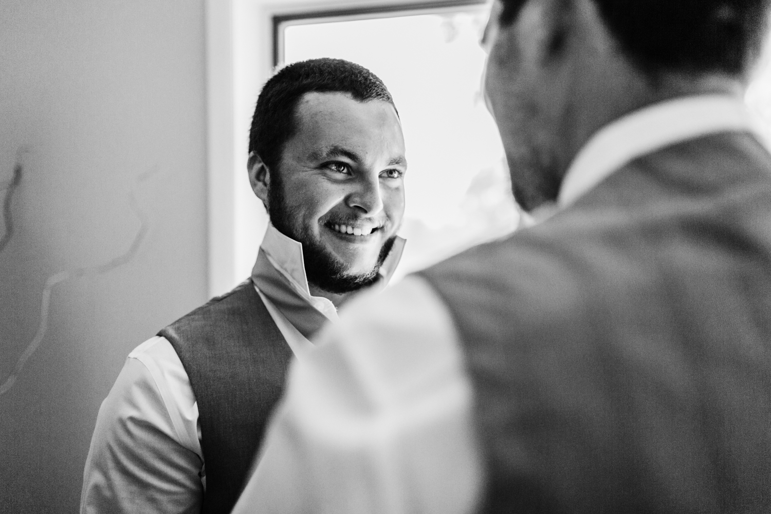 groom getting ready with groomsmen - maryland wedding photography and video