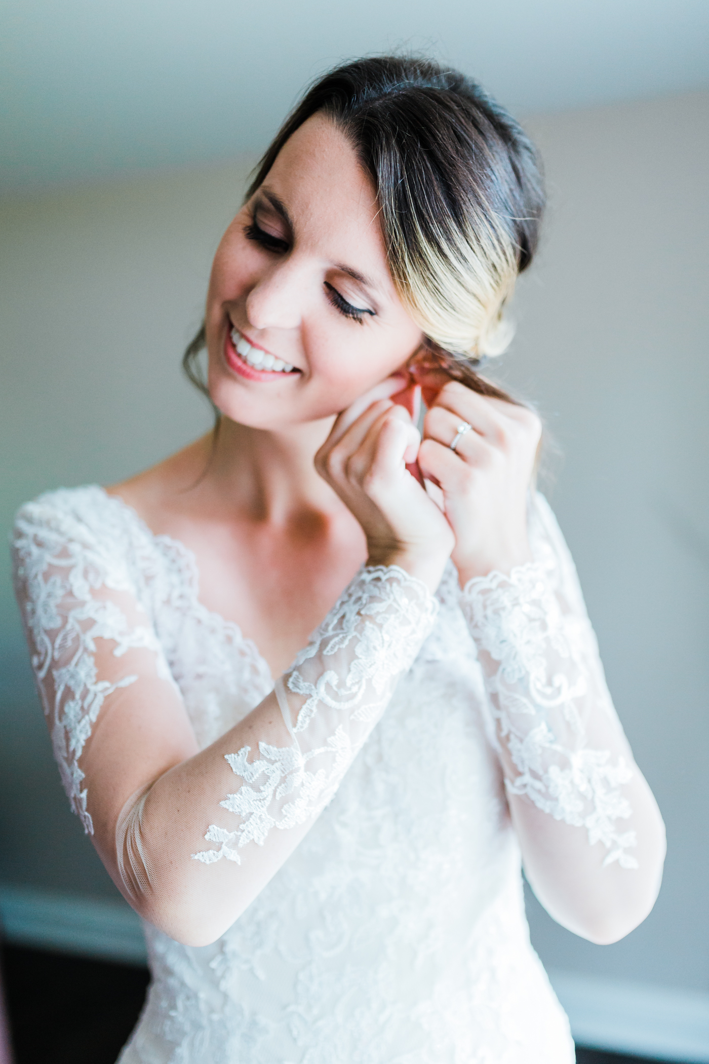 bride putting her earrings on - maryland wedding photographer and cinematographer - husband and wife team