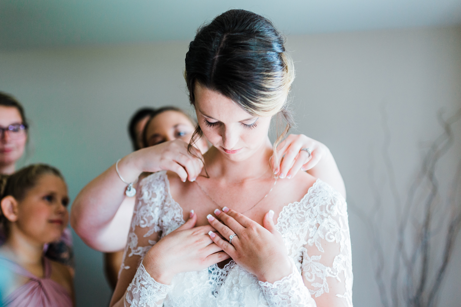 bride putting her necklace on as a memorial for her mom - md wedding