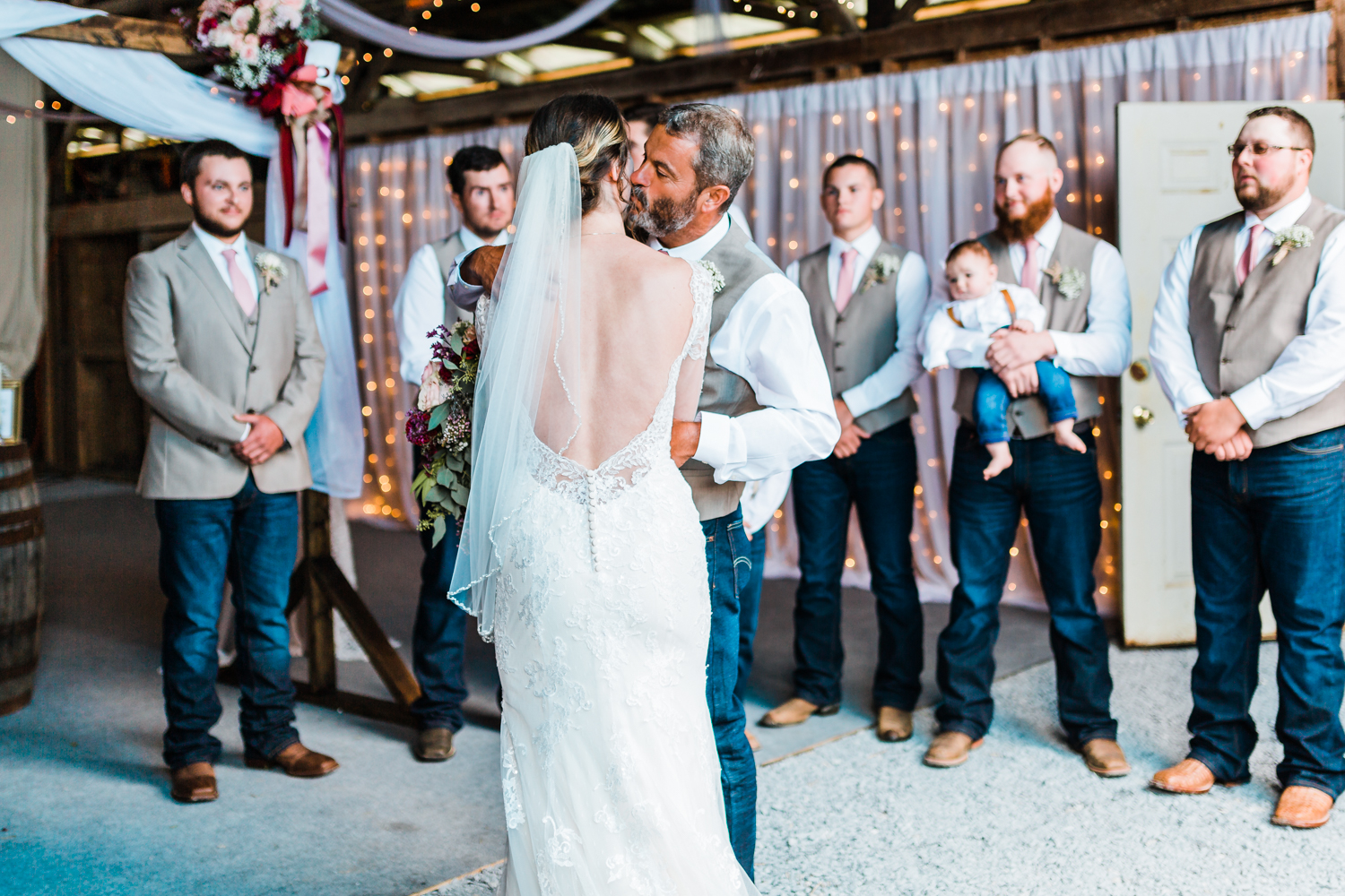 father kisses daughter as he gives her away - Frederick County, MD wedding